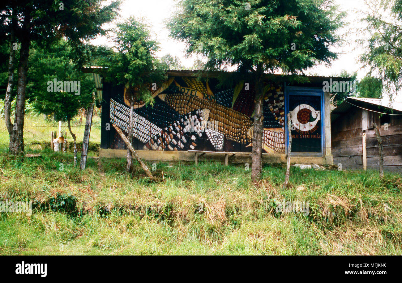 A mural on a building in Oventic, Chiapas State, Mexico, proclaims the historical importance of maize (corn) to the area's indigenous Maya population. - Stock Image