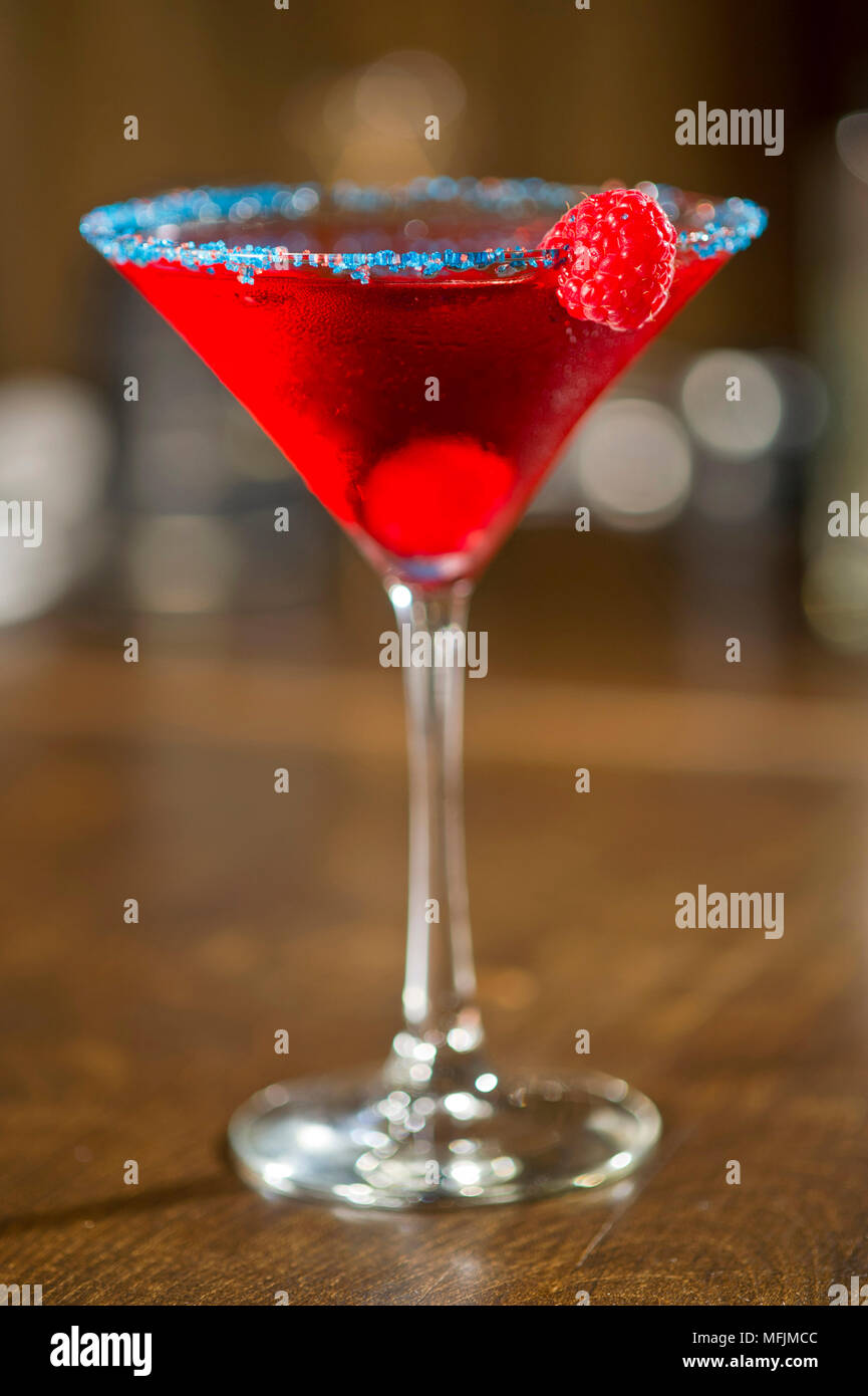 A Cosmopolitan cocktail at a restaurant. - Stock Image