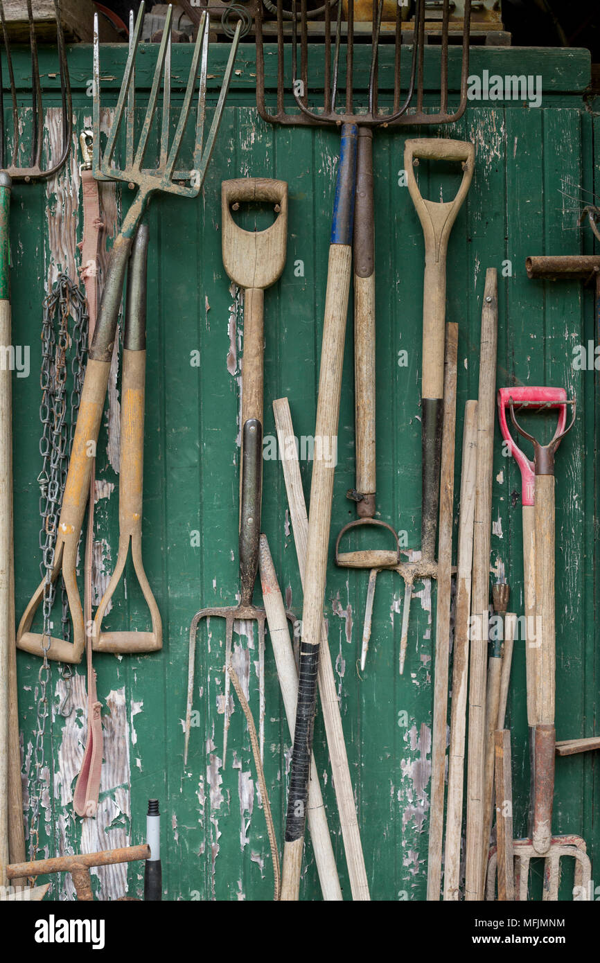 Tools hang on a wall at a garden in Northwest Arkansas. - Stock Image