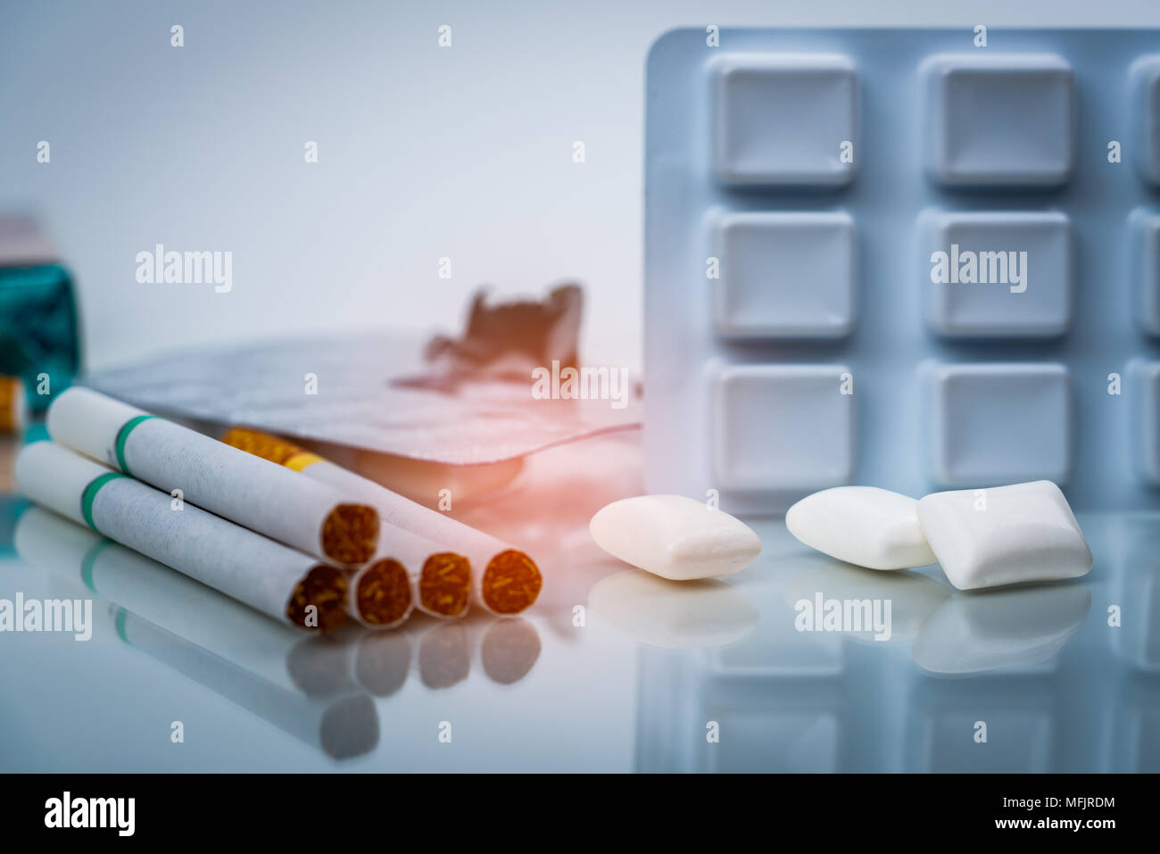 Nicotine chewing gum in blister pack near pile of cigarette. Quit smoking or smoking cessation and lung cancer concept. 31 May : World no tobacco day. - Stock Image
