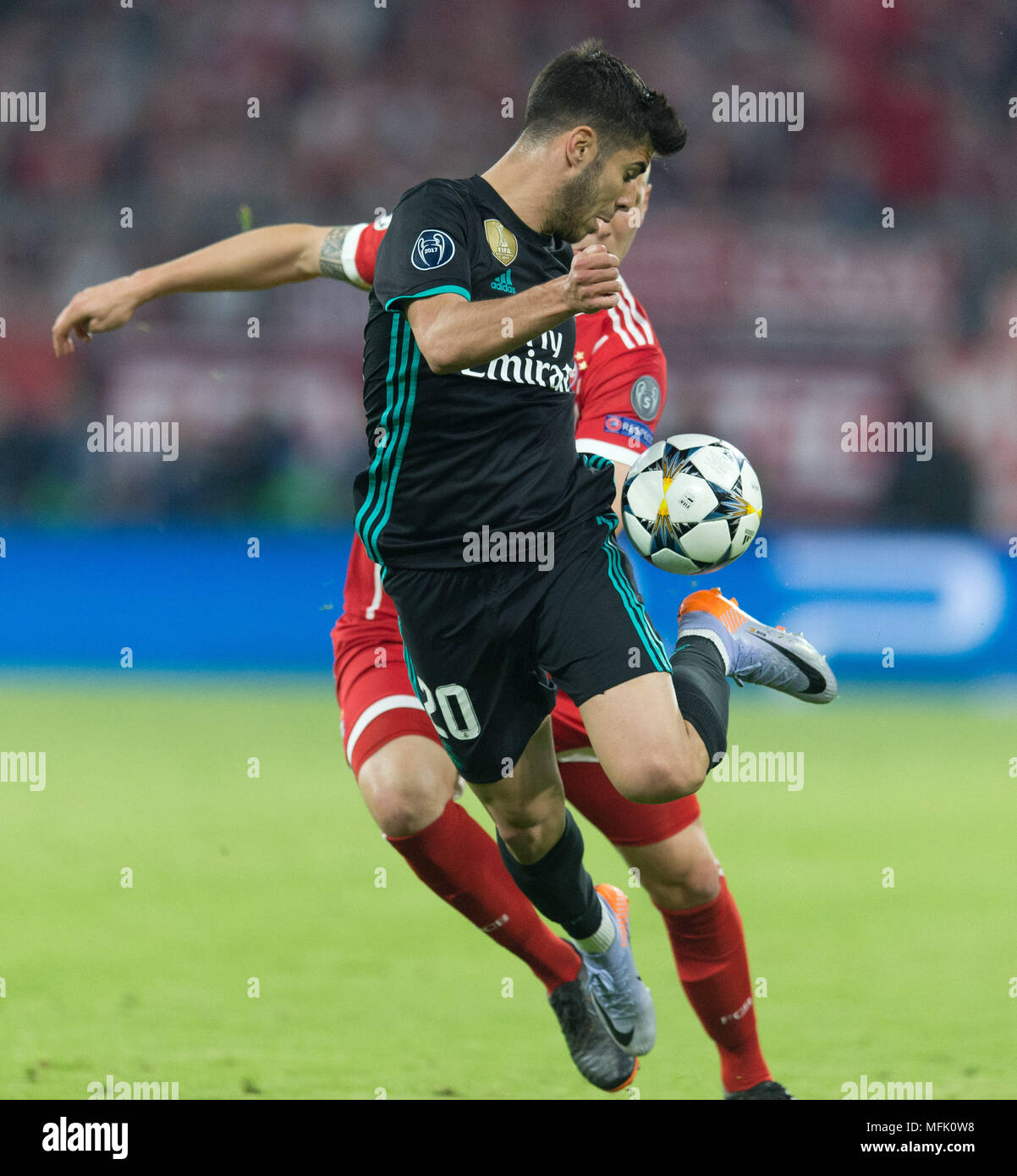 efdc331e411 Marco Asensio (Real Madrid) takes the ball with a hoe. Behind him Niklas  Suele (FCB) GES   Football   Champions League semi-finals  FC Bayern Munich  - Real ...
