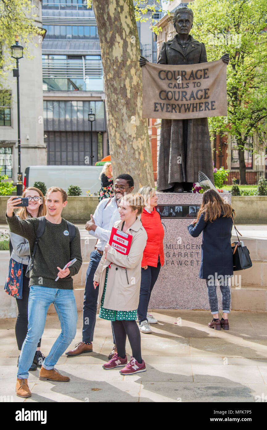 London, UK. 26th Apr, 2018. Labour Party local election campaigners pose for a selfie - 8ft 4in bronze statue of the suffragist campaigner Millicent Fawcett is now in the shadow of the Houses of Parliament following a campaign led by Criado-Perez. It was created by Turner prize-winning artist Gillian Wearing, and shows Fawcett when she became president of the National Union of Women's Suffrage Societies. Credit: Guy Bell/Alamy Live News - Stock Image