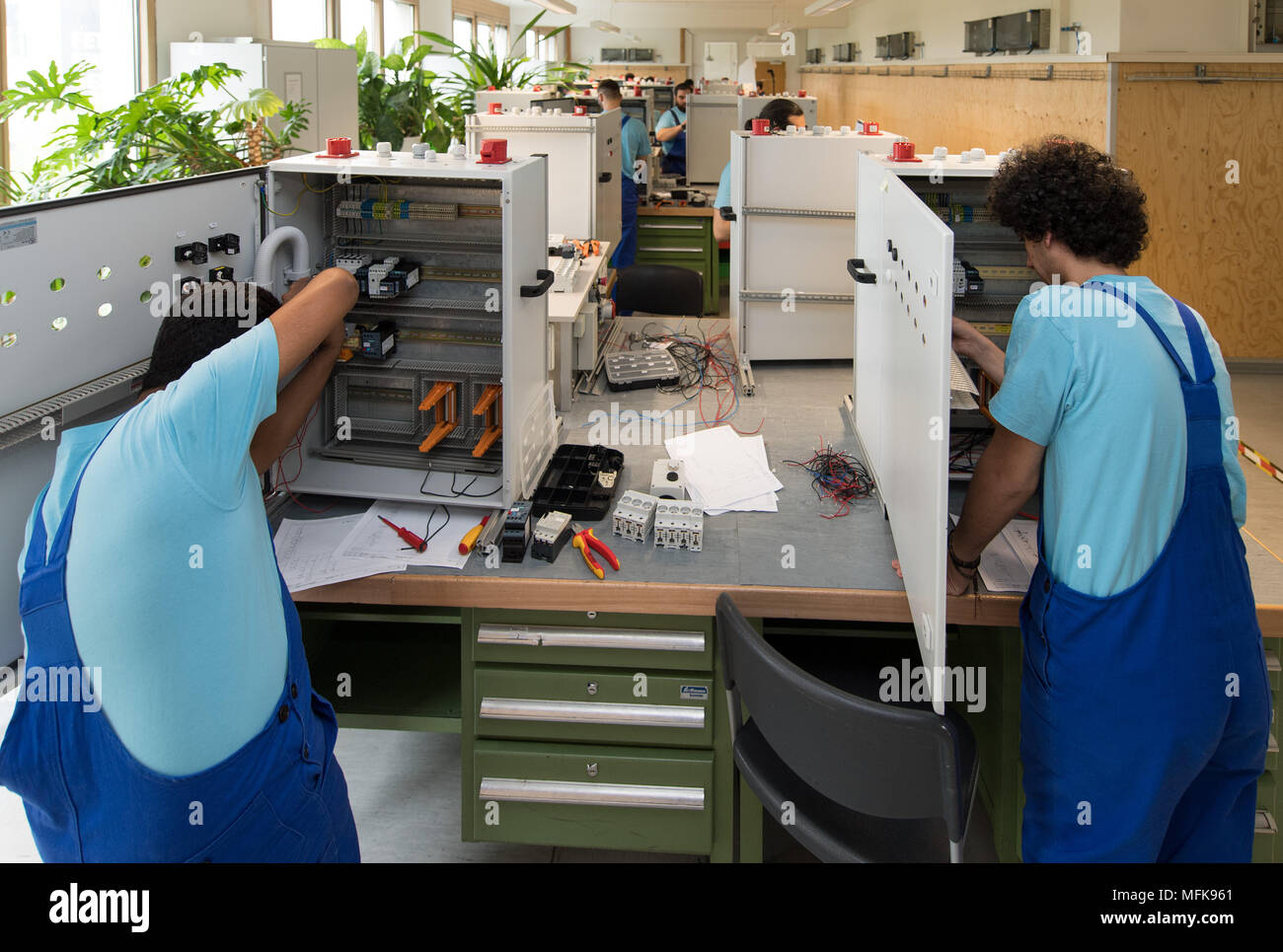 26 April 2016 Germany Leipzig Refugees Working On Wiring In An Electrical Training Enclosure At The Centre Of Siemens Professional Education