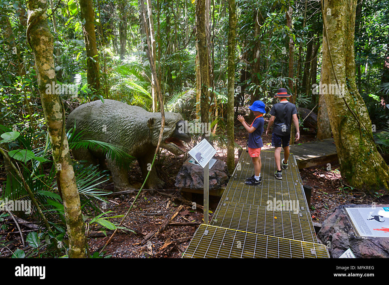 Children looking at an extinct giant wombat Diprotodon in the Jurassic Forest, Daintree Discovery Centre, Daintree National Park, Fa - Stock Image