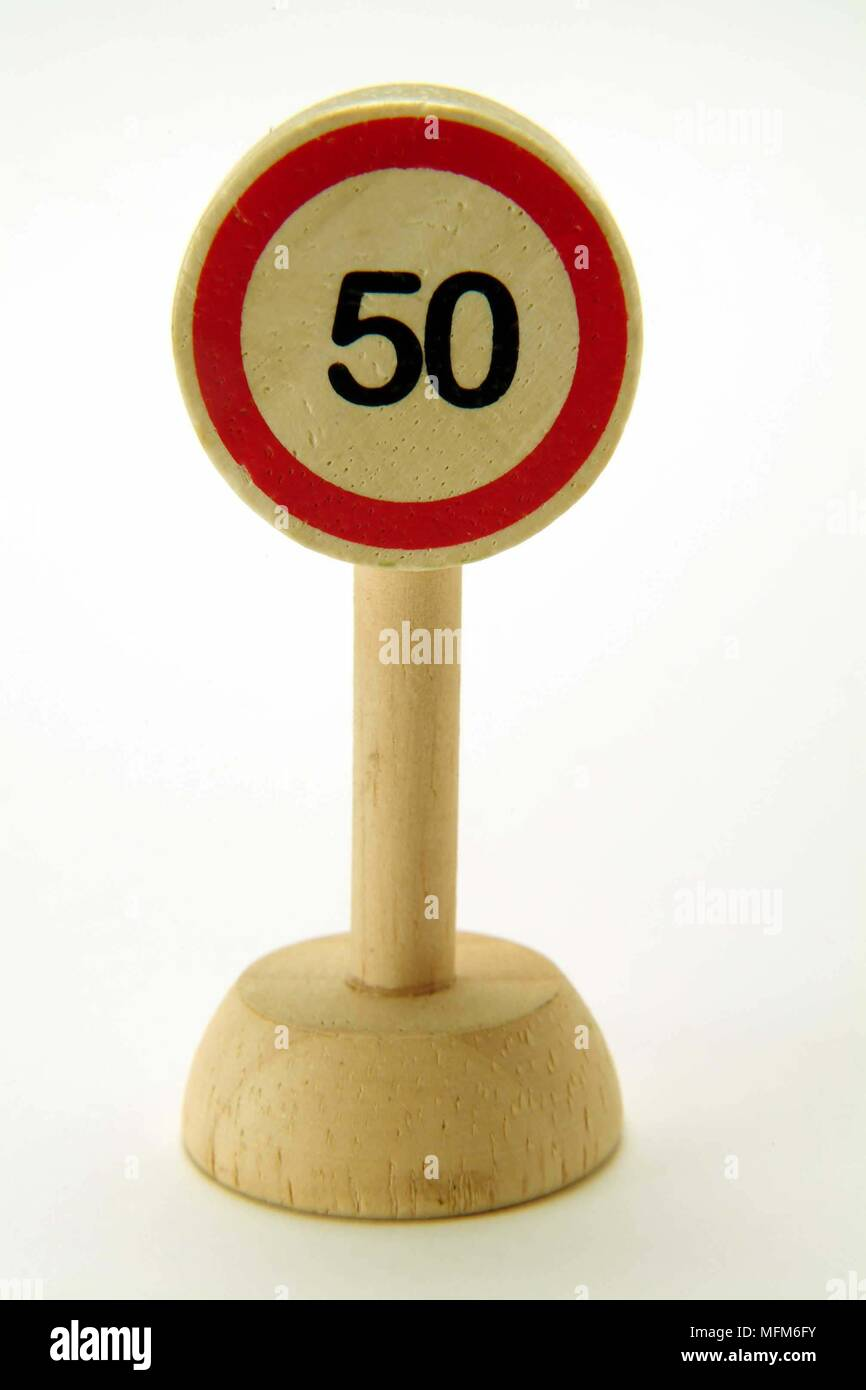 A straight on view of a simple wooden toy road sign showing a speed limit of 50 MPH traffic direction.  Bandphoto / COMPULSORY CREDIT: Hotshoe/Photosh Stock Photo