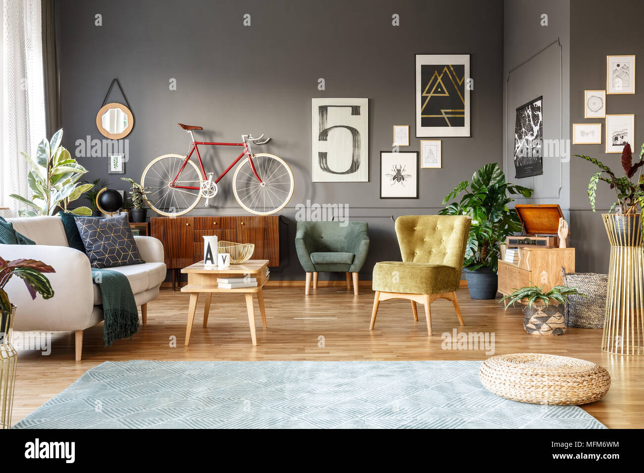 Pouf On Grey Carpet In Spacious Living Room Interior With Green Armchairs,  Posters And Red Bike