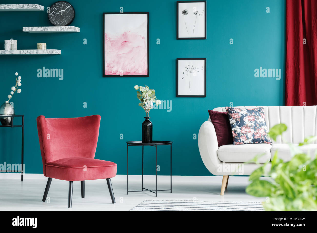 Red Armchair, White Sofa, Paintings And Black Table In A Green Living Room  Interior