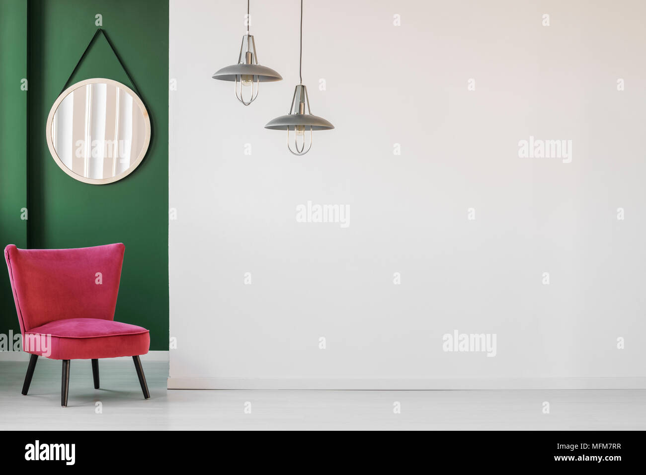 Minimalist Living Room Interior With White Empty Wall Comfortable Retro Chair And A Round Hanging Mirror In Green Corner