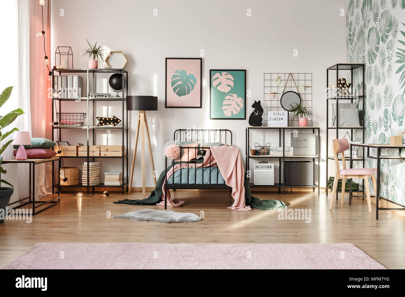 Pastel pink and emerald green decorations and textiles in botanical ...