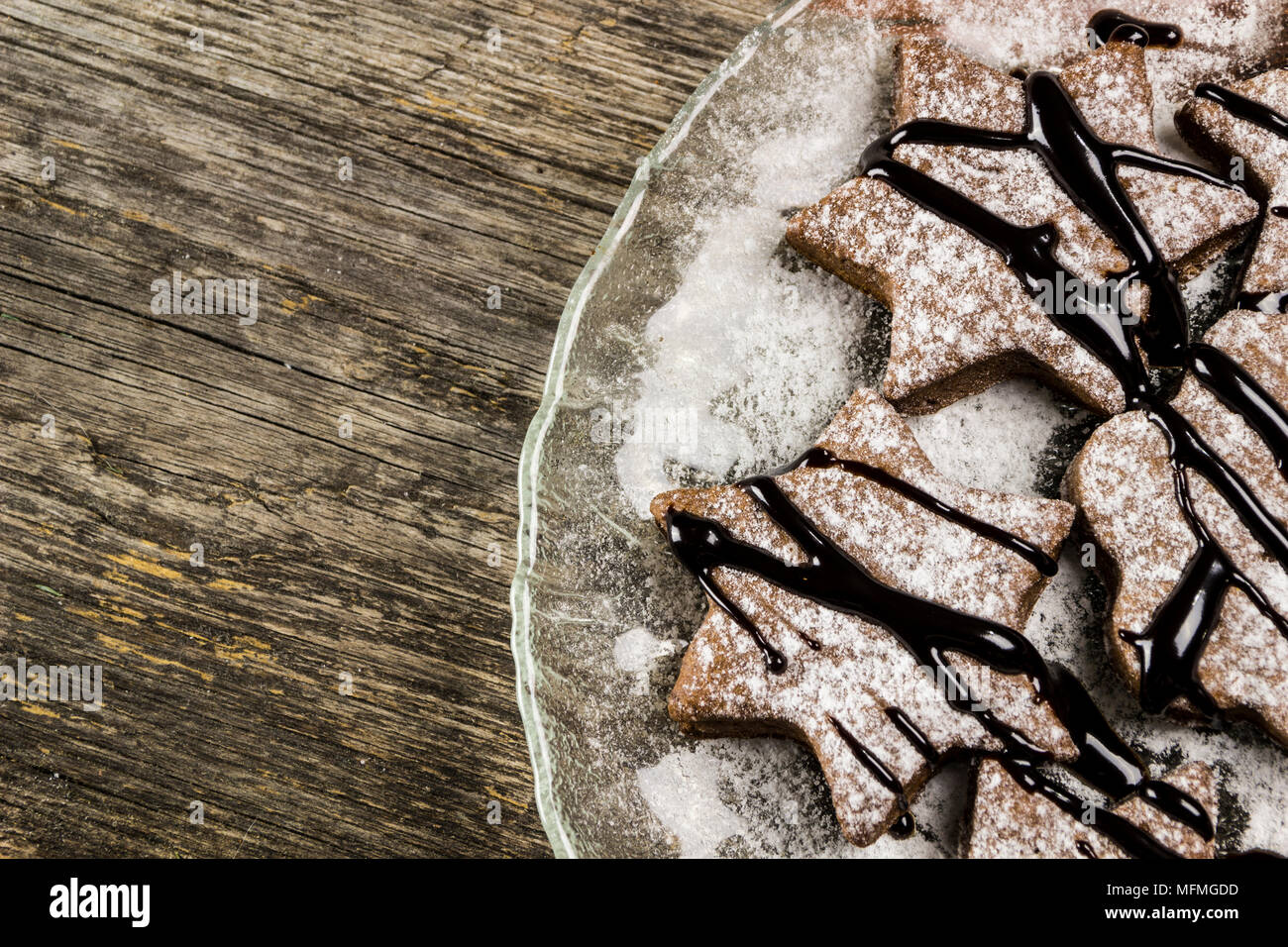 Ginger biscuits with chocolate cream on a wooden background - Stock Image