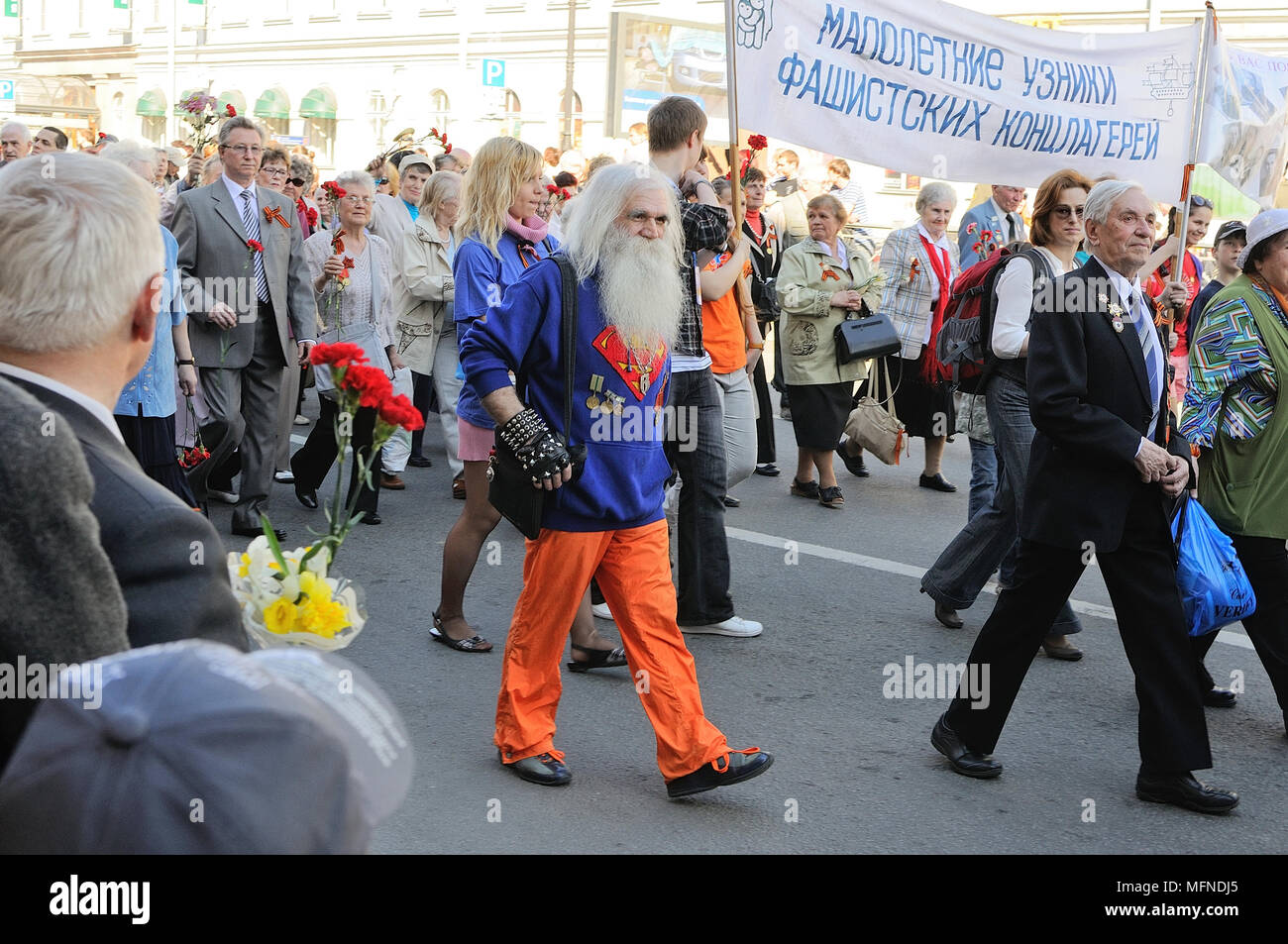 Procession of veterans of World War II on Victory Day,Banner 'Young prisoners of fascist camps' - Stock Image