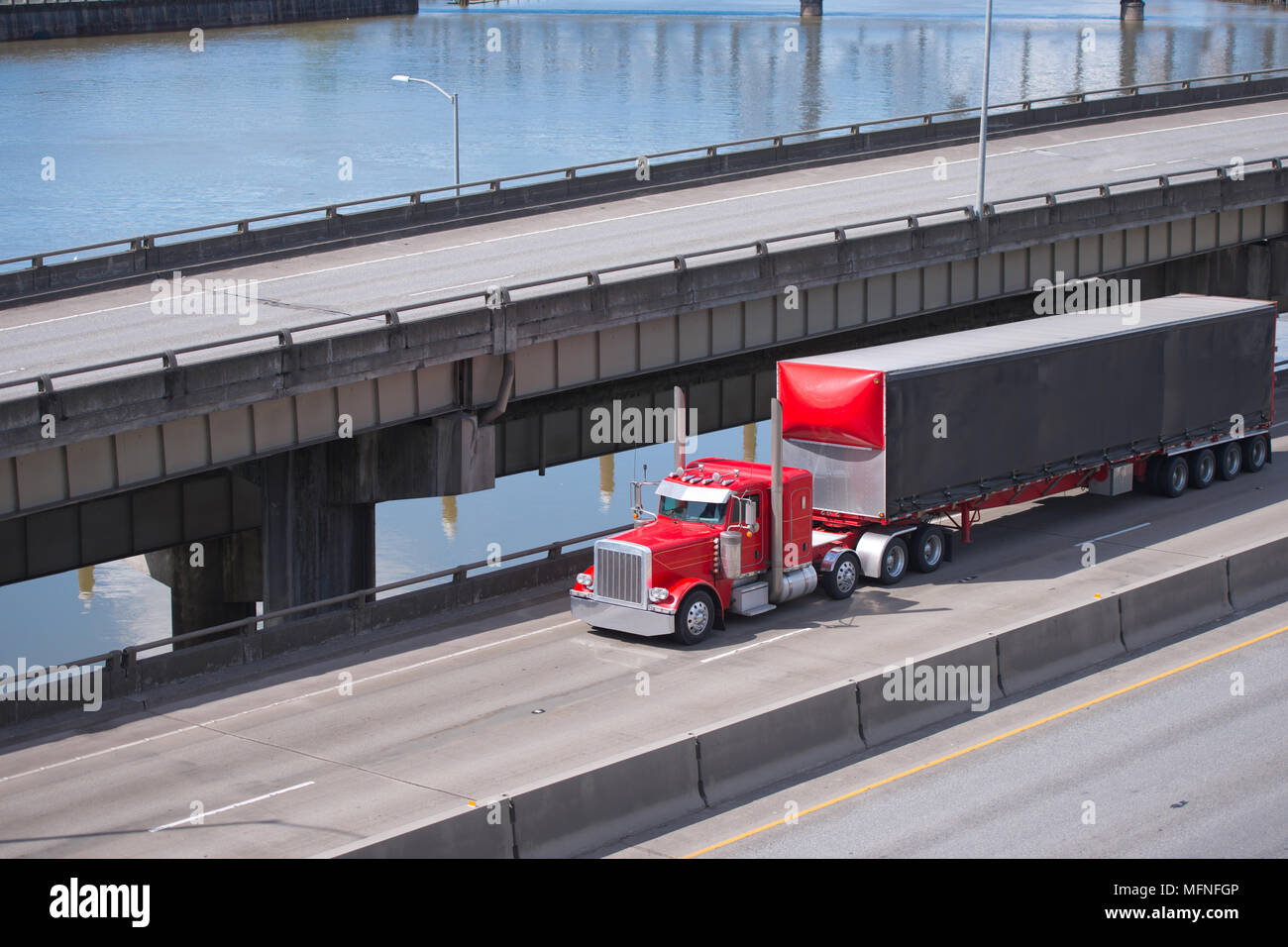big rig red classic american semi truck transporting commercial cargo in covered dry van semi trailer