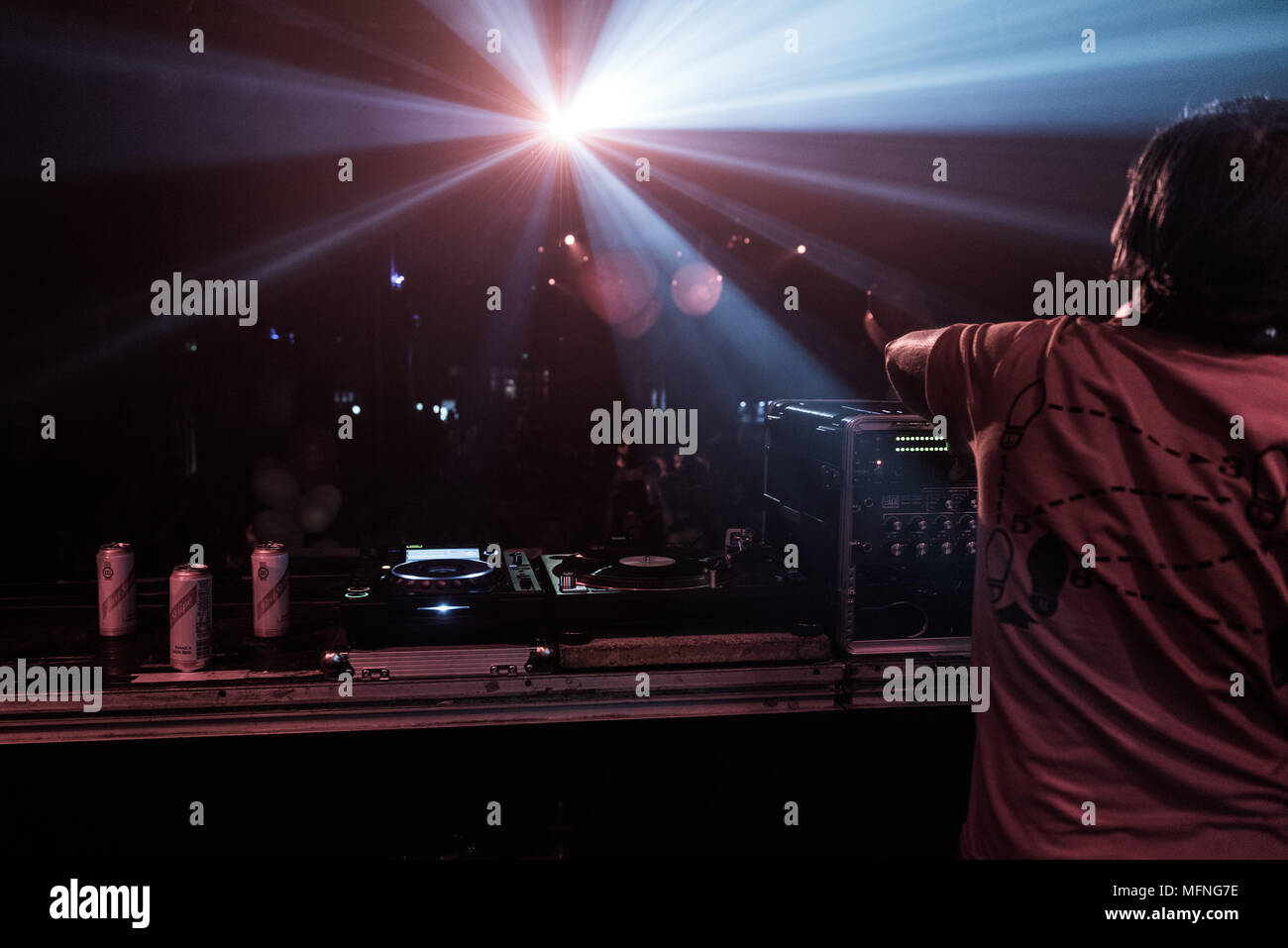 Music Shot DJ and Audience Light show with flair - Stock Image