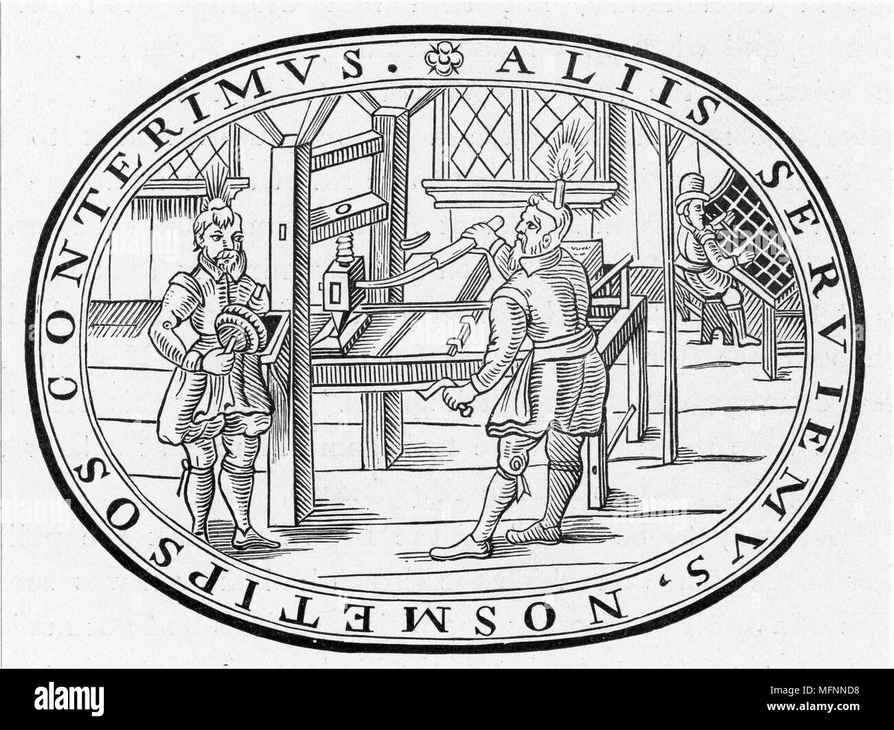 English printing workshop. In right background the compositor is selecting type from a case. At left the printer's assistant holds the inking pads while, in the centre, the printer, with candle attached to his head so that he can see his work, operates the press - Stock Image
