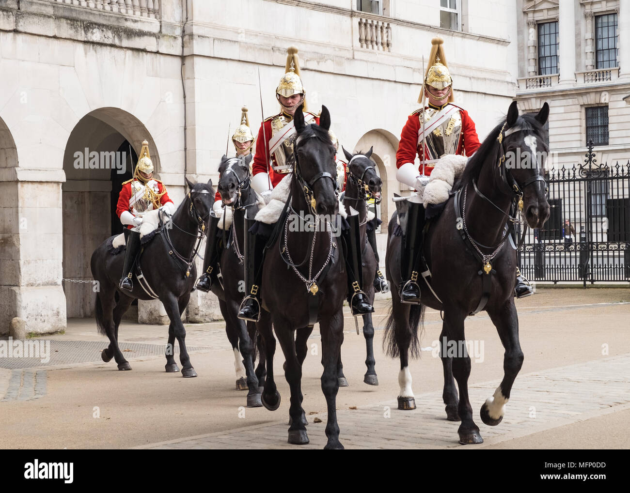 London horseguards, mounted household cavalry also known as lifeguards on black hoses in full dress uniform. - Stock Image