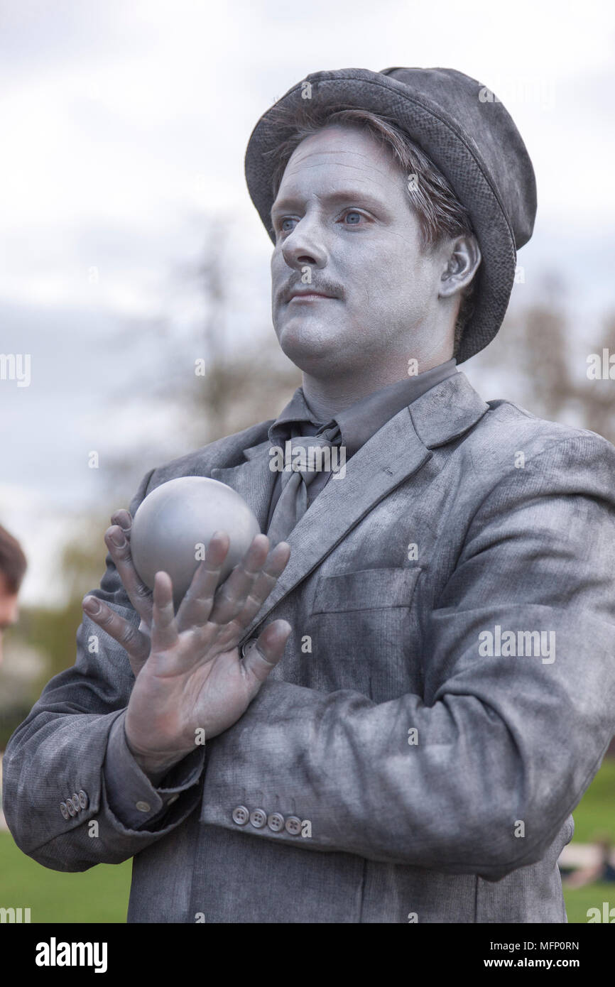 Stratford upon Avon, Warwickshire, 22nd April 2018. The Silver Hand, British artist no S04. The final day of the U.K's First Living Statue Competition - Stock Image