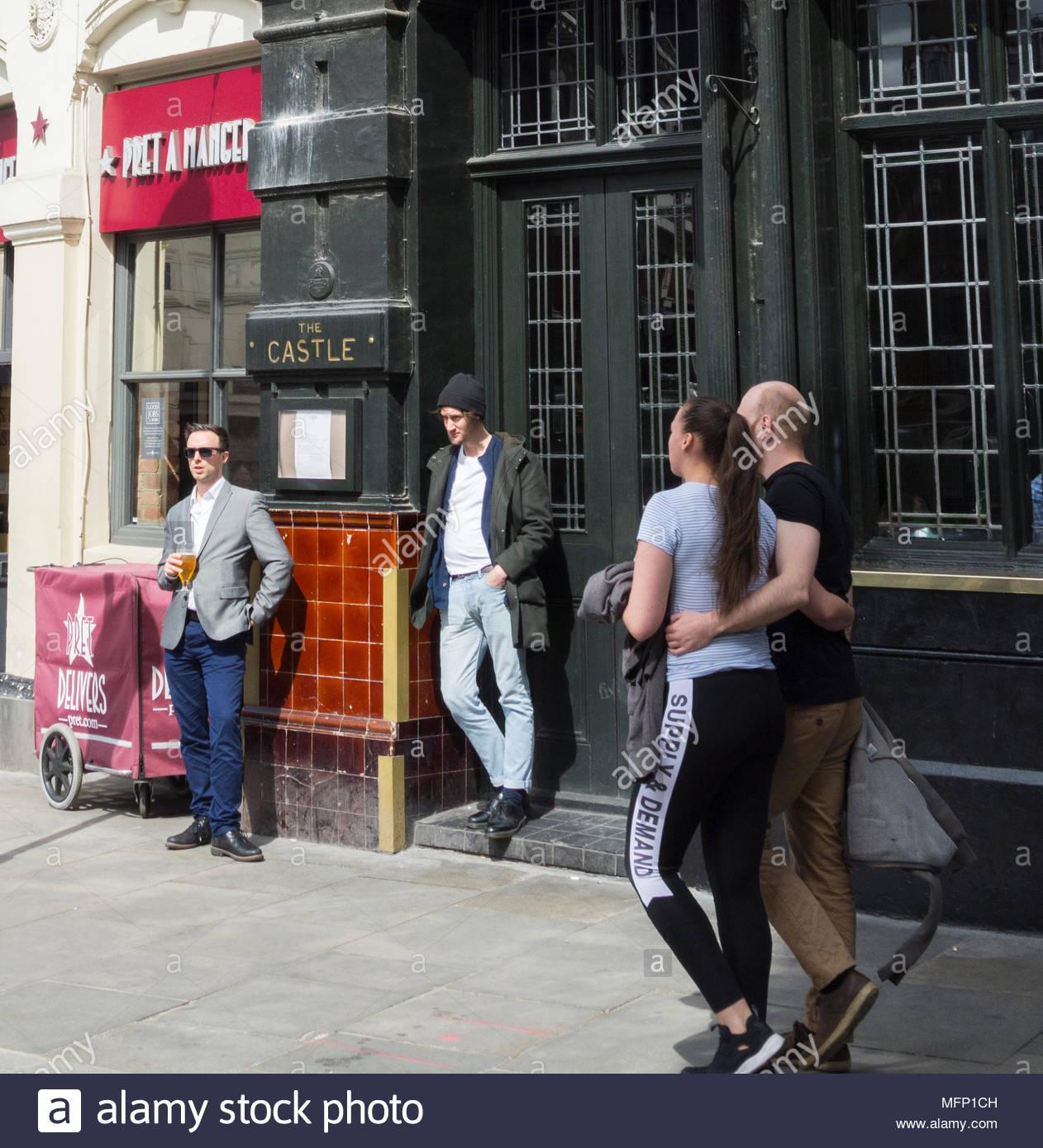 Men drinking outside the Castle, Public House, on Cowcross Street, Farringdon, London, EC2, UK - Stock Image
