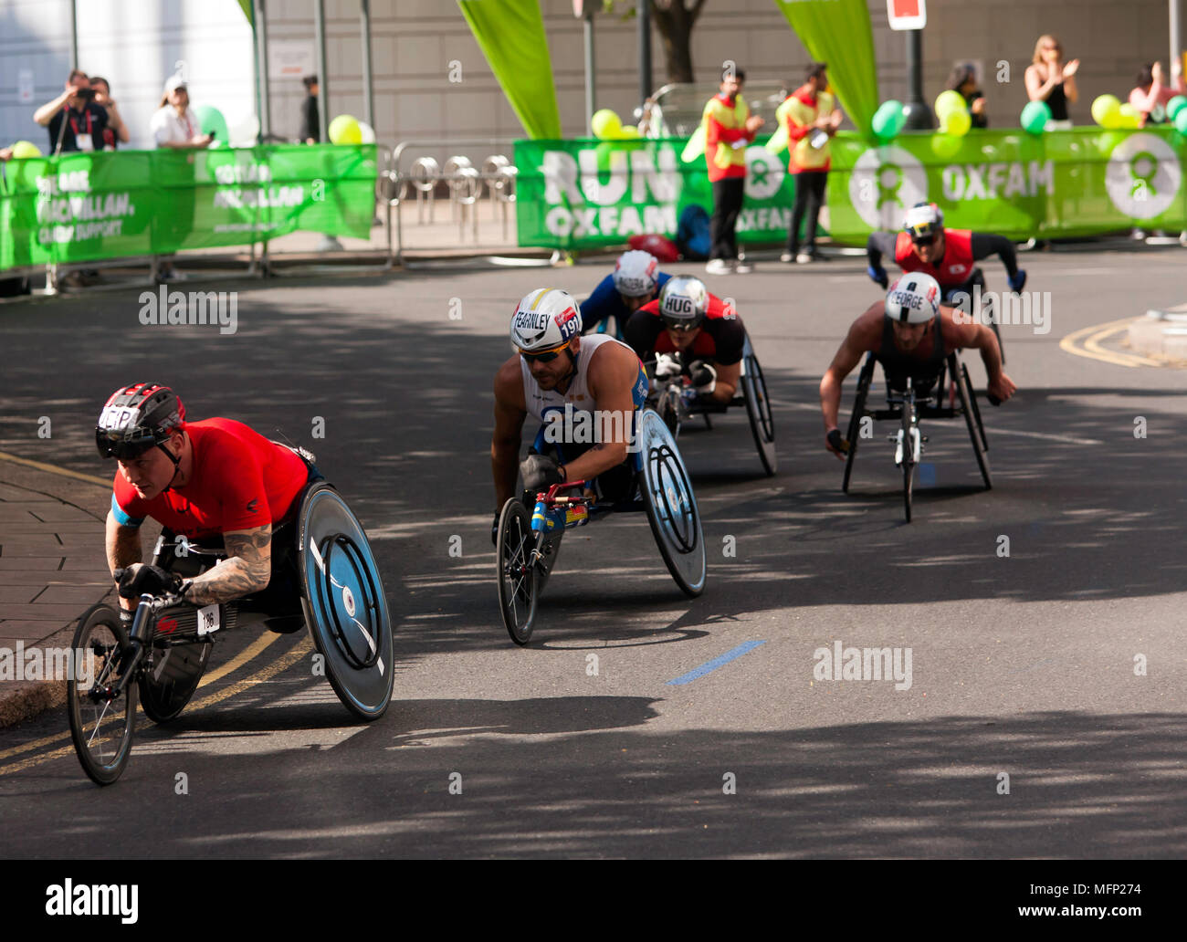 The Elite Mens Wheelchair Athletes pass through Cabot Square, during the 2018 London matrathon. David Wier (Black helmet) won in a time of 01.31.15, - Stock Image