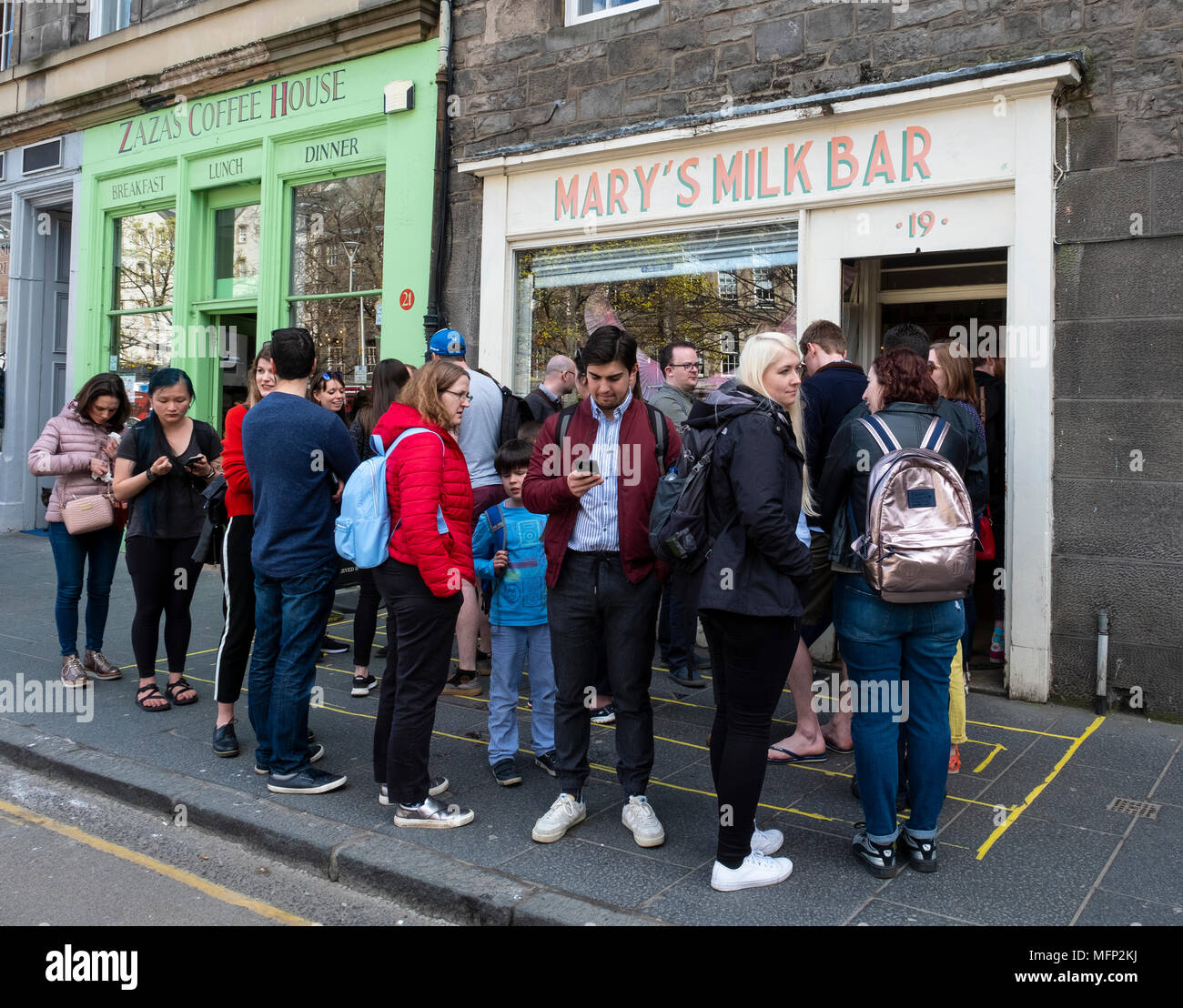 Queue of people outside Mary's Milk Bar on Grassmarket in Edinburgh Old Town, Scotland, UK - Stock Image