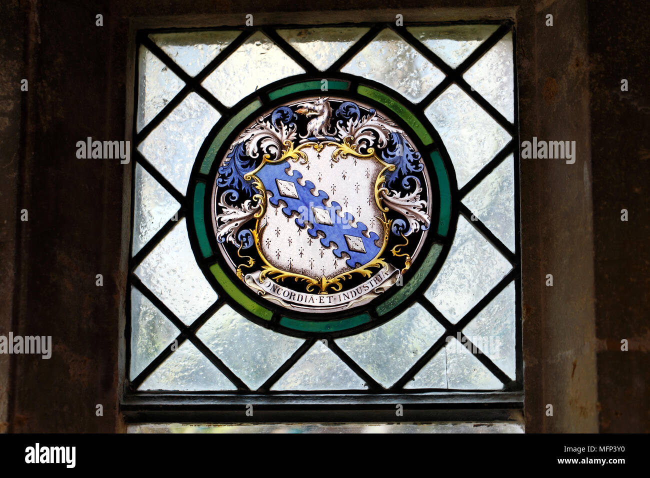 Concordia et industria, Dent family coat of arms, showing three lozenges on a field of blue. Stock Photo