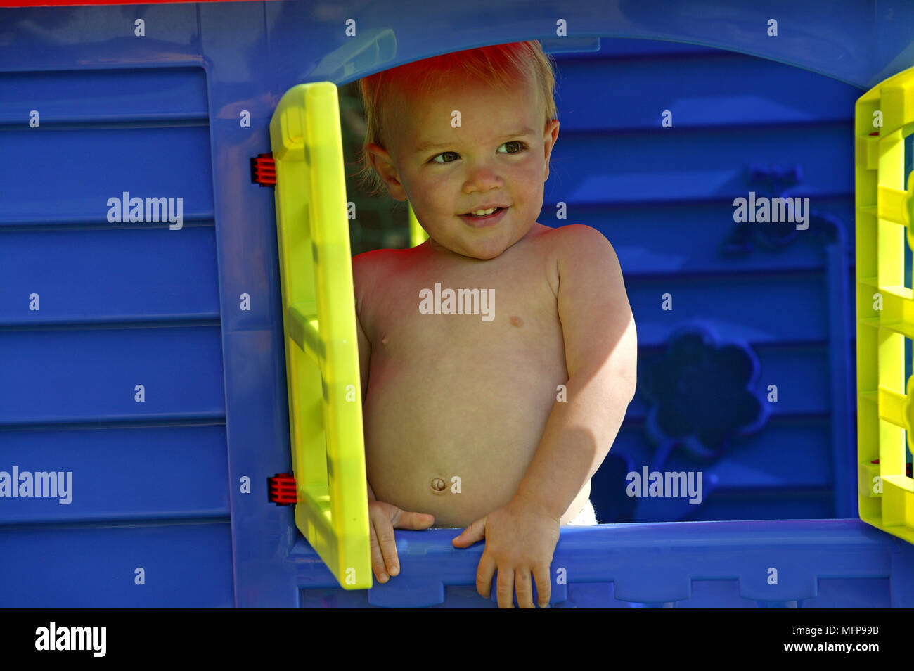 Boy playing in his Toy House - Stock Image