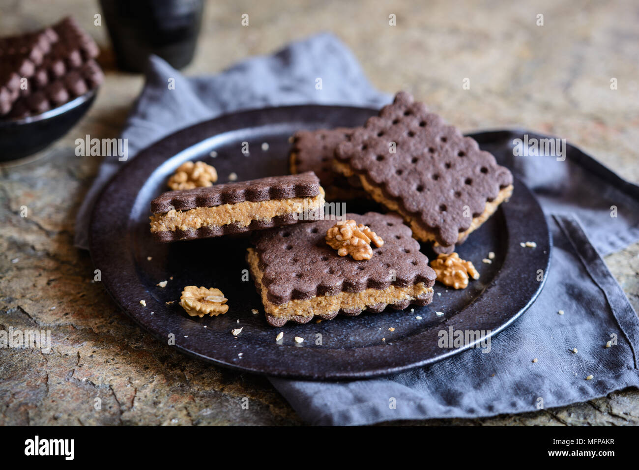 Delicious cocoa sandwich biscuits stuffed with walnut and coffee filling - Stock Image