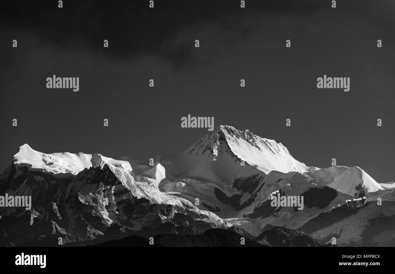A peak in the Annapurna mountain range, Nepal. Black and white photograph. - Stock Image