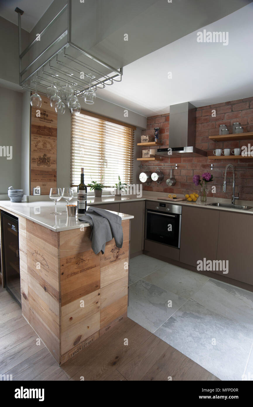 modern kitchen with exposed brick wall and peninsula unit hong kong rh alamy com kitchen design with exposed brick wall