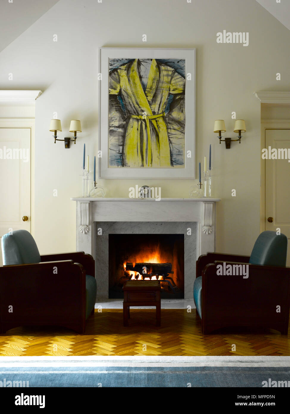 Deco Design New York two art deco style armchairs either side of lit fire in
