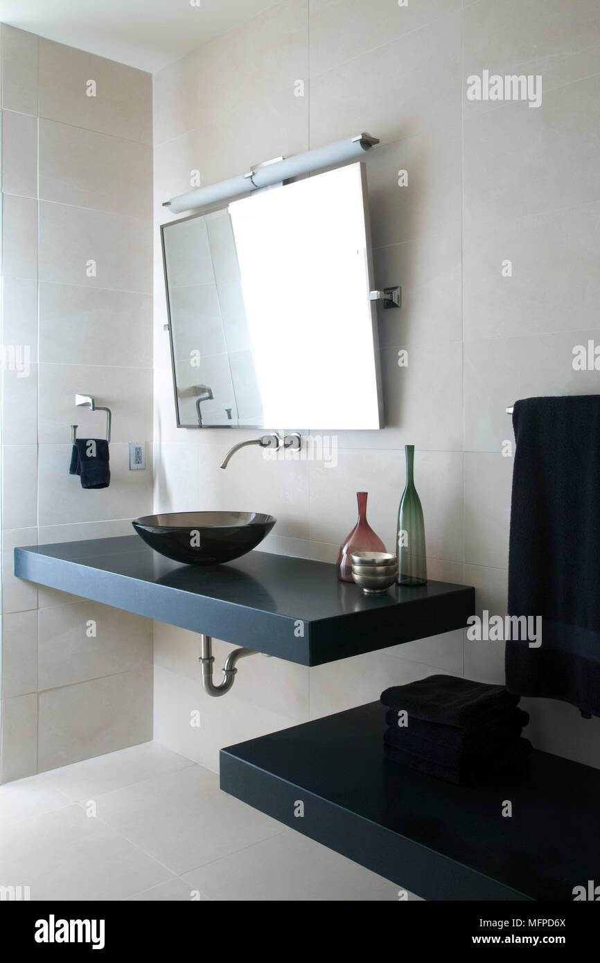 Mirror above glass bowl washbasin on shelf in modern bathroom, New ...