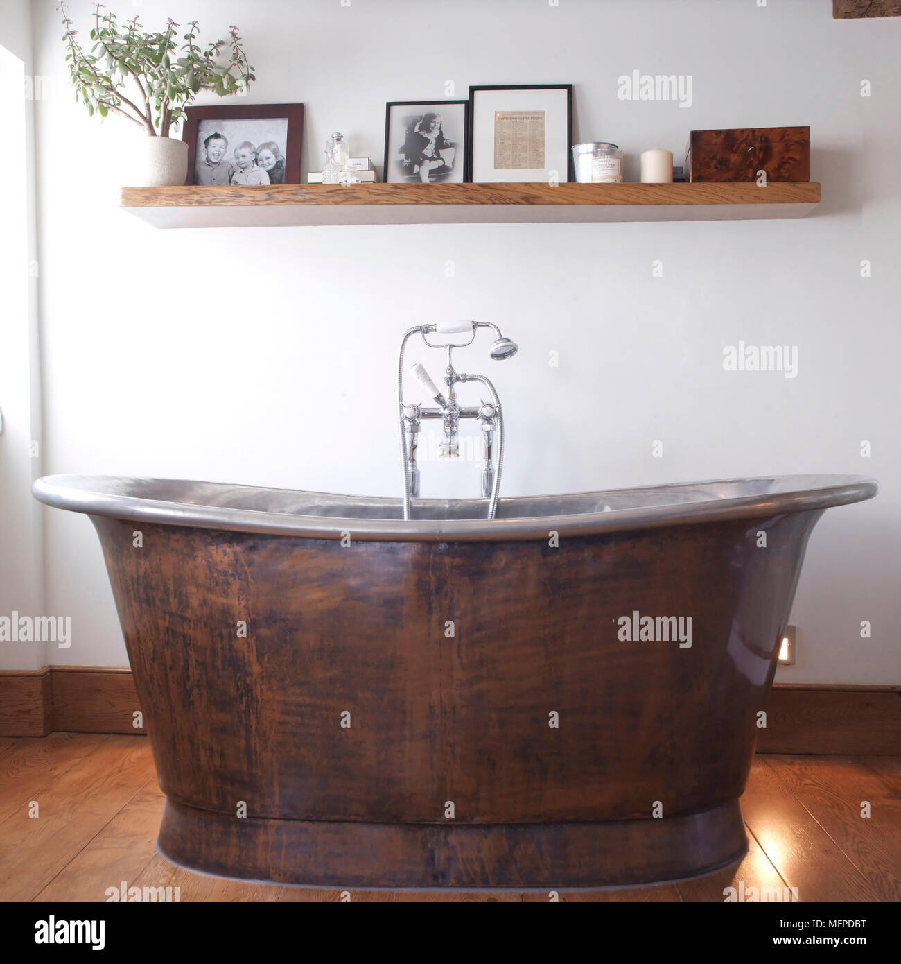 Freestanding Old Fashioned Bathtub In Centre Of Country Style Bathroom
