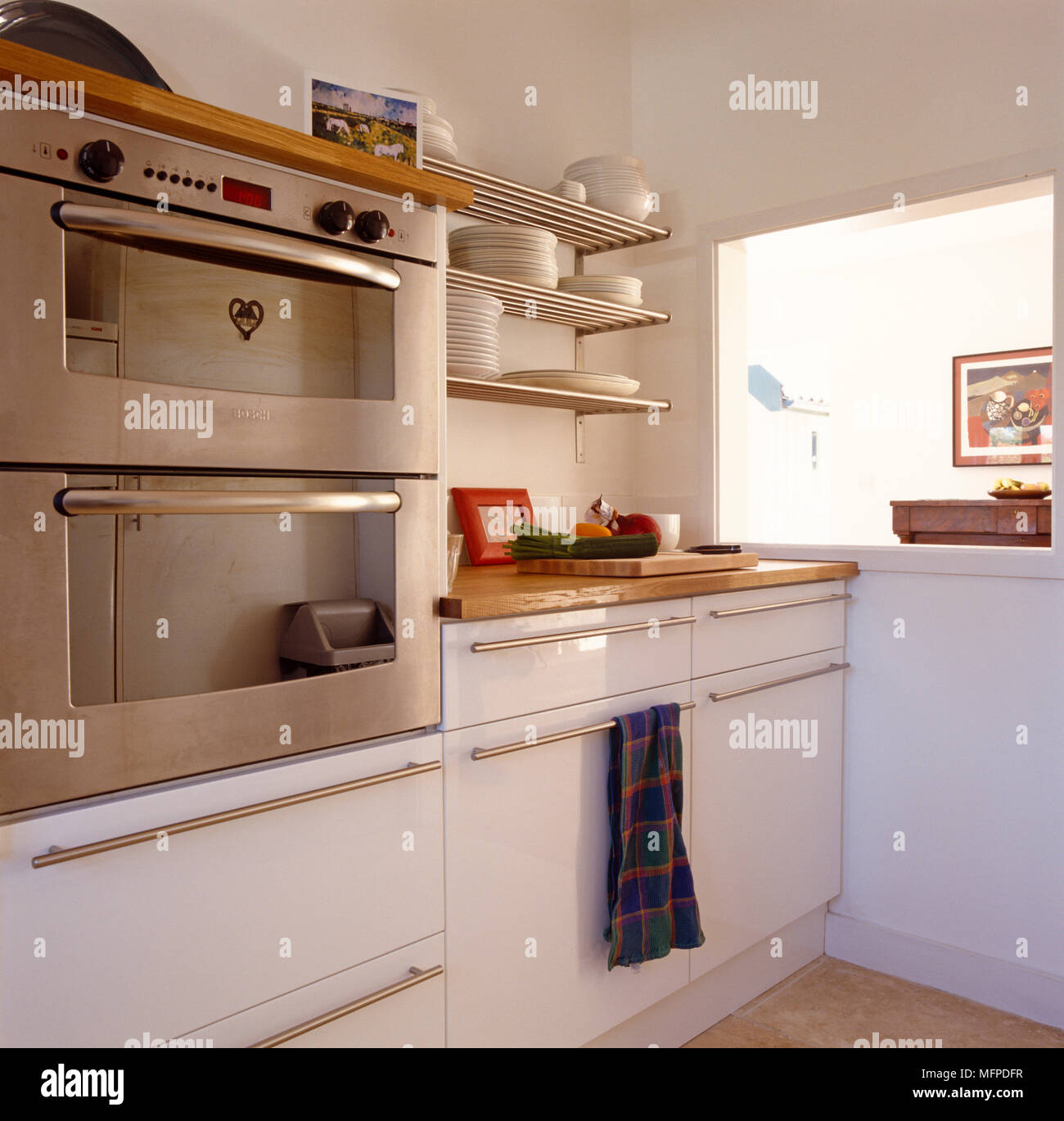 Kitchen With Wooden And Stainless Steel Cabinets Appliances