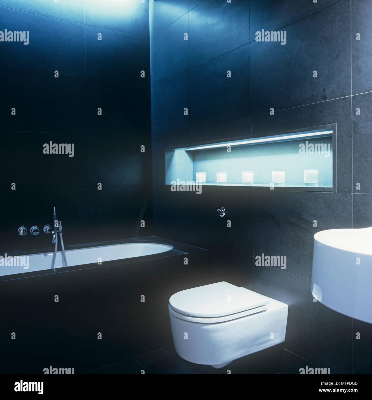 Matt black granite bathroom with toilet and bathtub Stock Photo ...