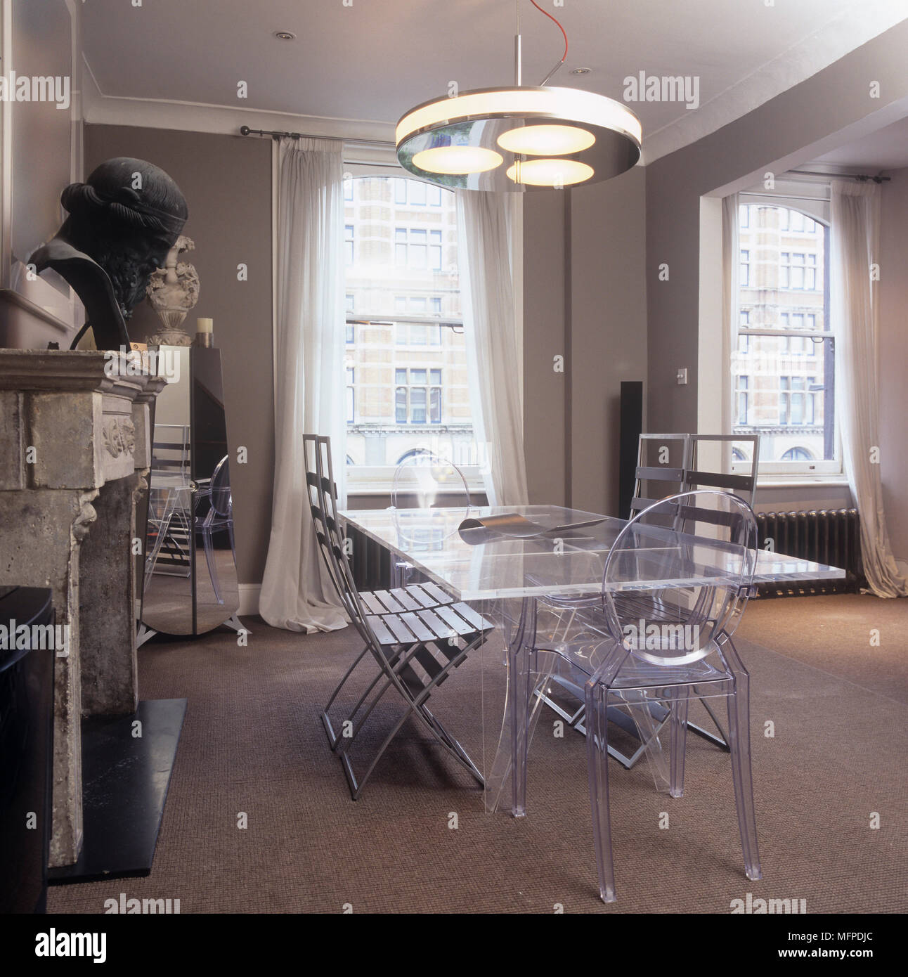 Perspex table and matching philippe starck louis ghost chairs perspex table and matching philippe starck louis ghost chairs stock photo 181817172 alamy arubaitofo Gallery