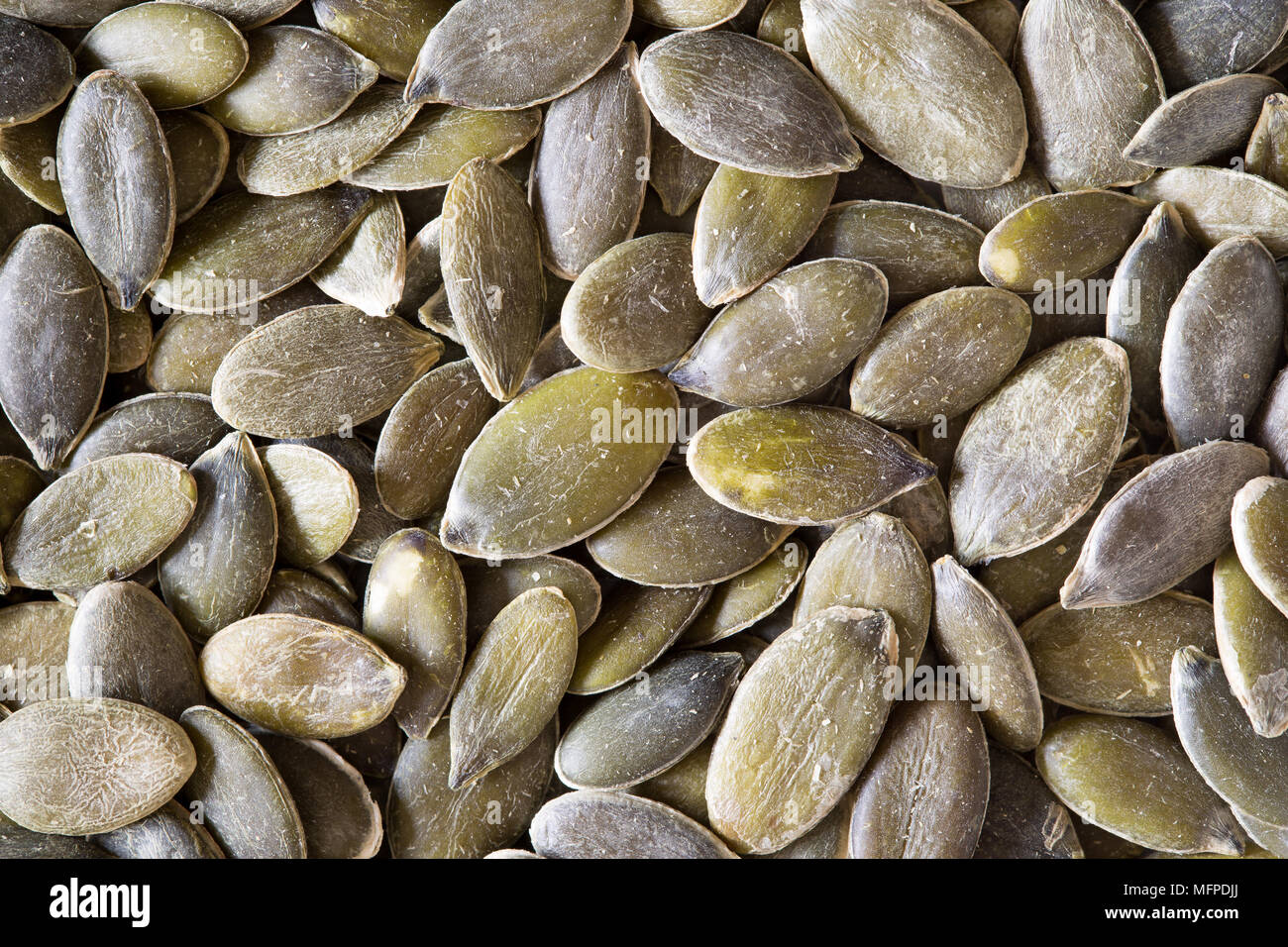 Close up of raw, organic, highly nutritious pumpkin seeds ...