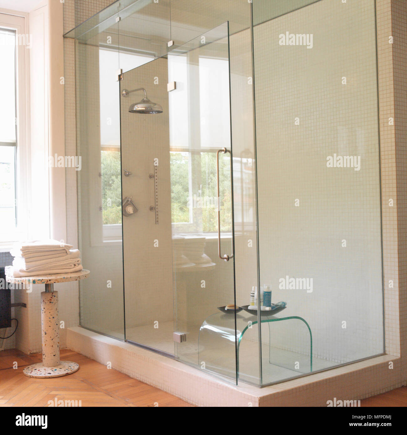 Detail of a large modern glass panelled shower unit in a bathroom ...