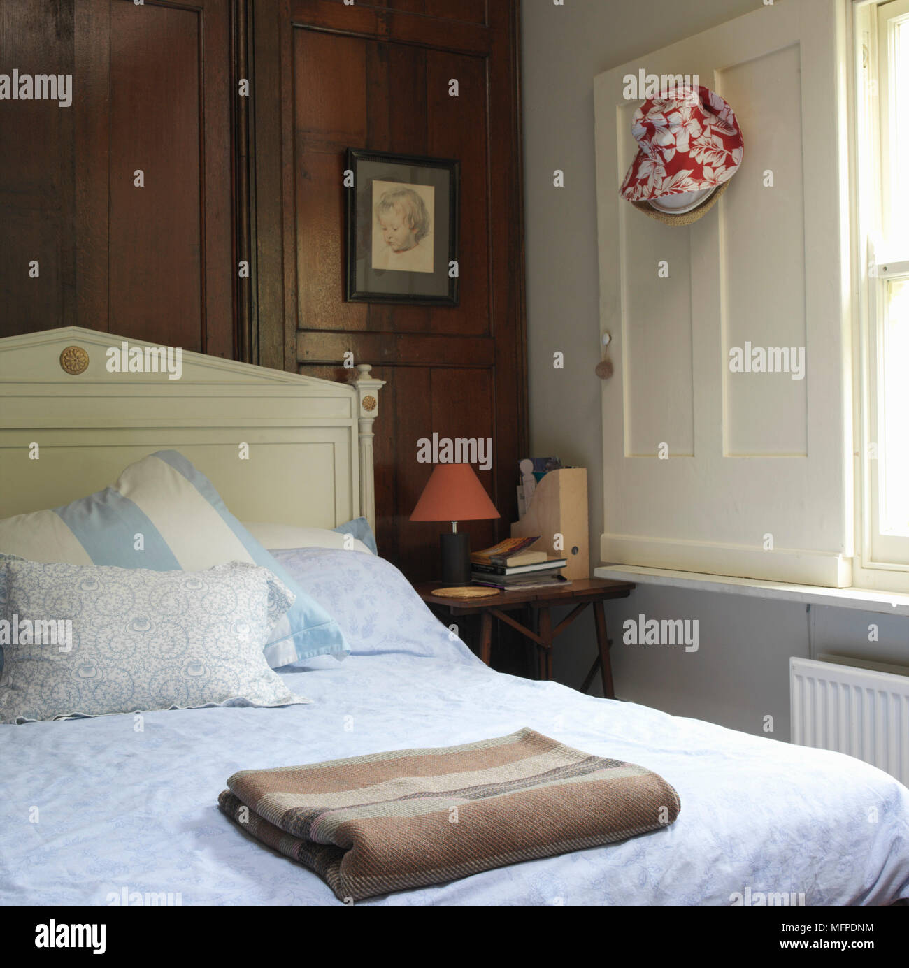 Detail Of A Traditional Bedroom Double Bed With A Wooden Headboard
