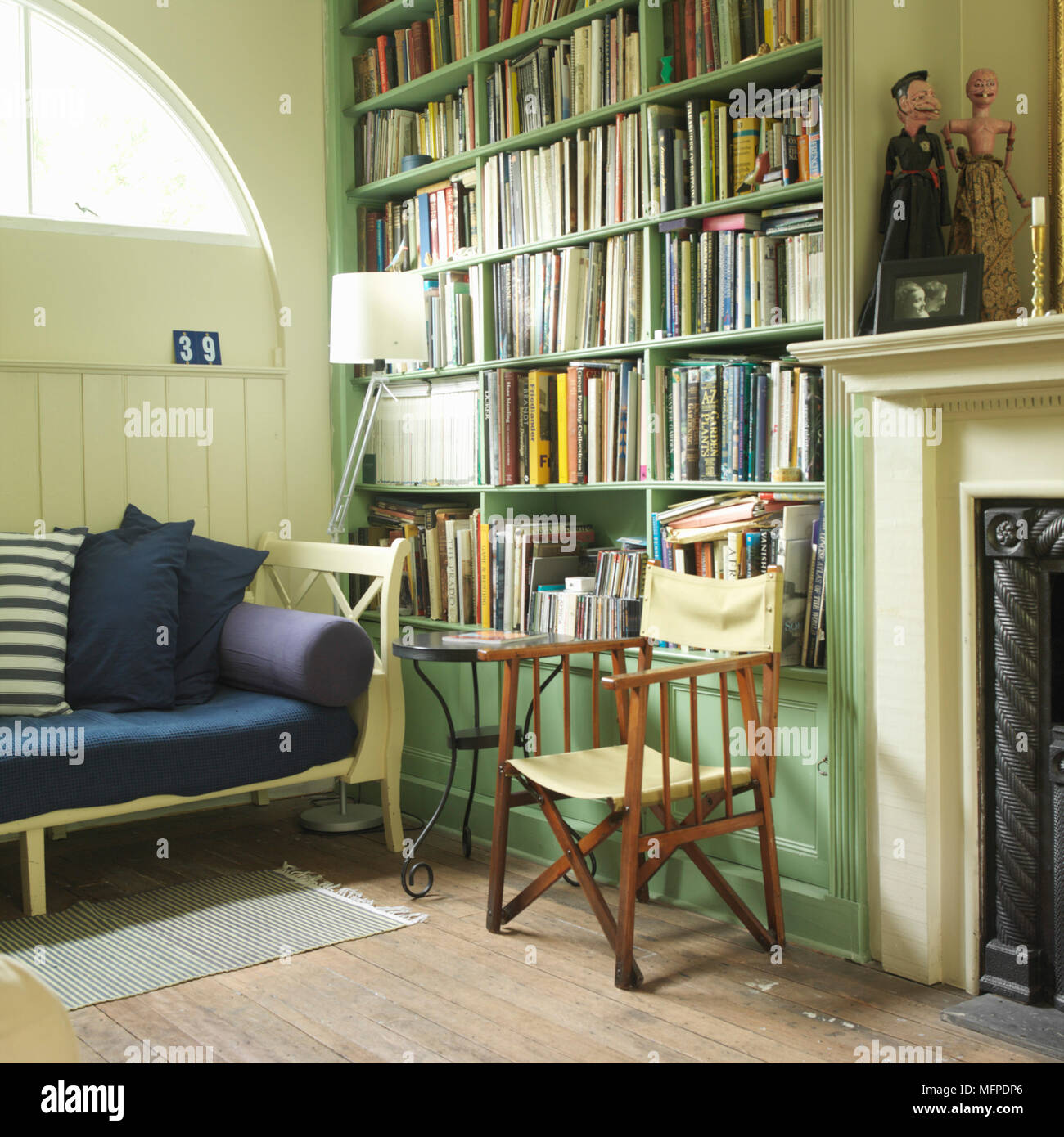 sitting room detail with built in bookshelves wood frame sofa rh alamy com