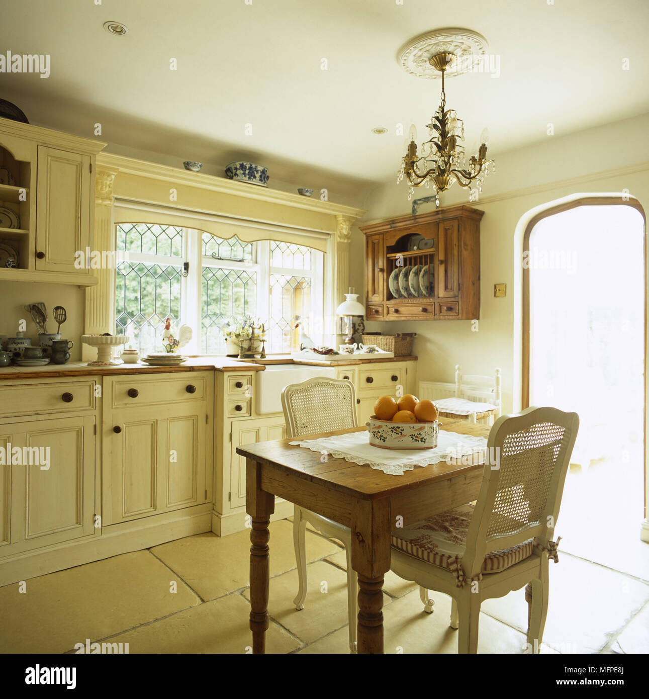 A Traditional Kitchen With A Flagstone Floor And A Small Dining