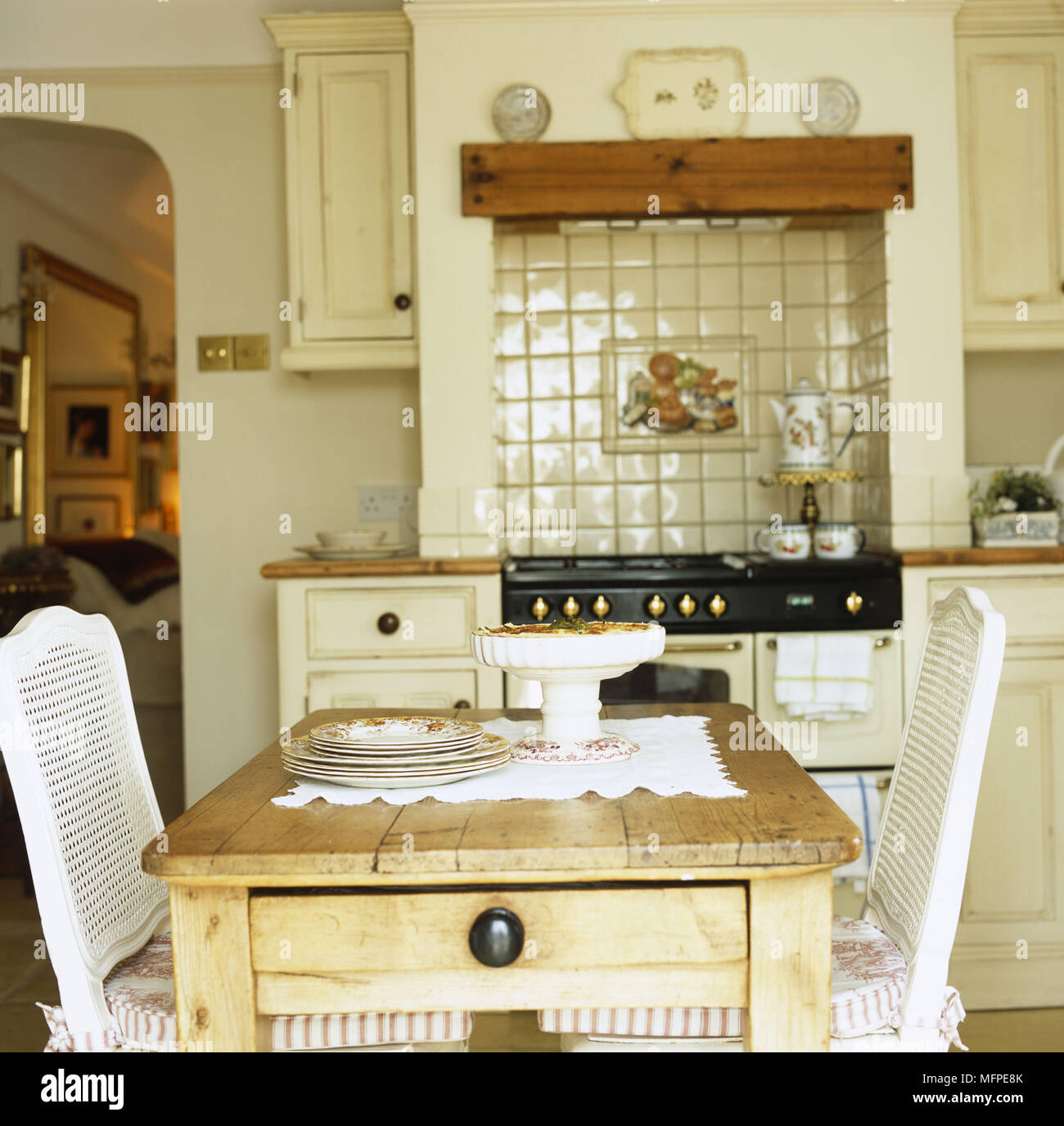 Kitchen Interior With Pink Furniture And Tiles Stock: Interiors Kitchen Aga Traditional Stock Photos & Interiors