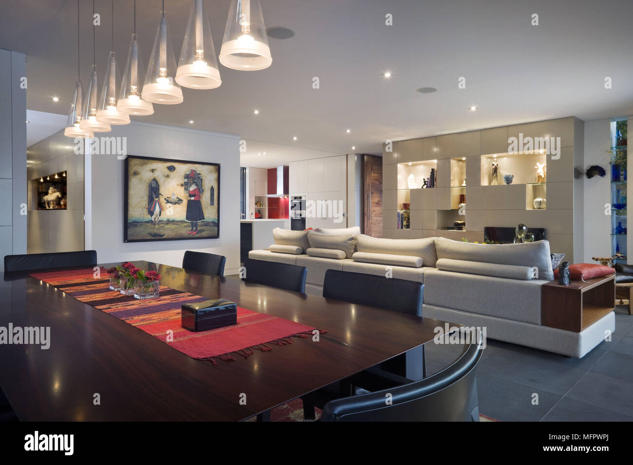 Ceiling Lights Suspended Above Dining Table In Modern Open Plan Room