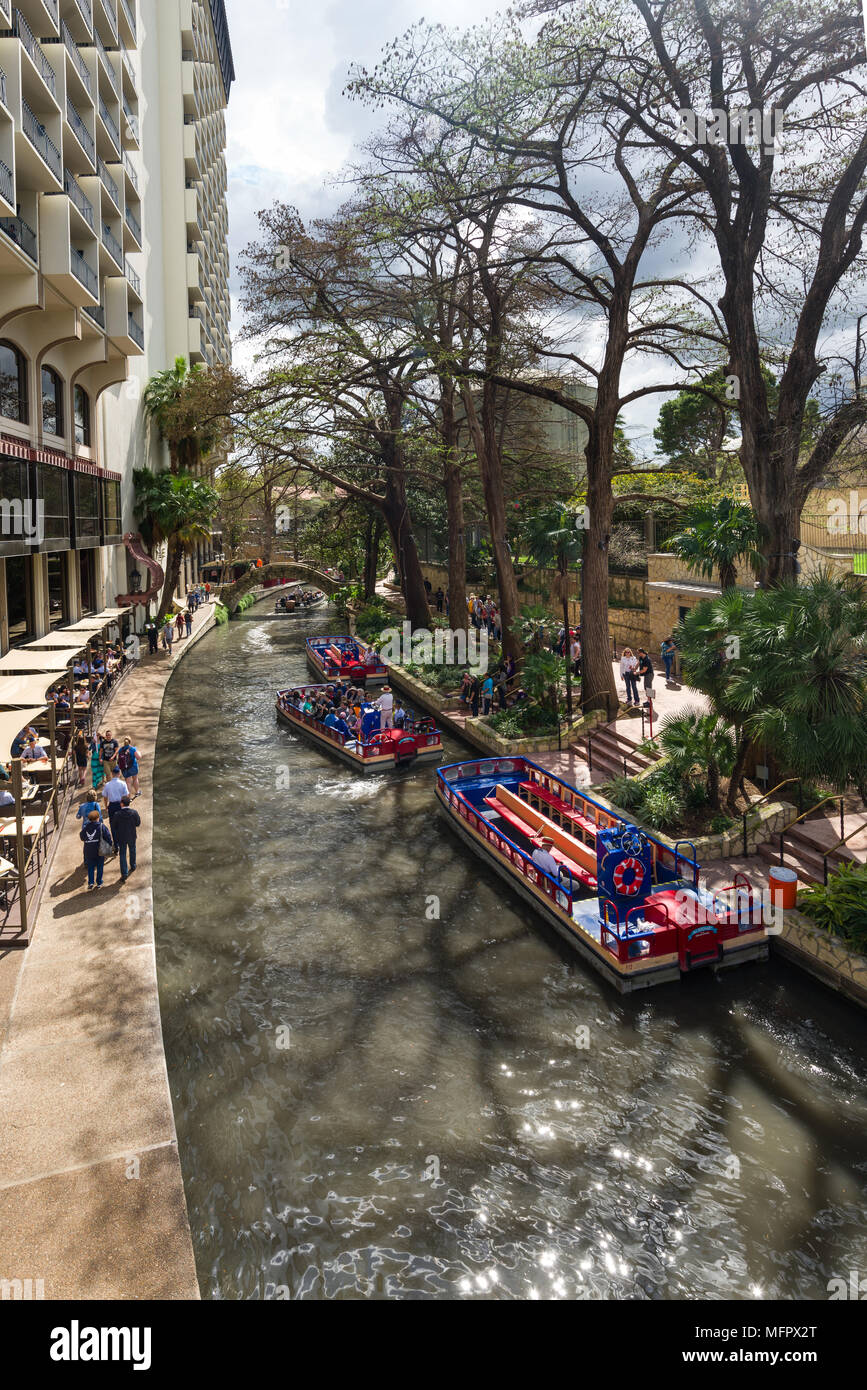 Part Of The San Antonio Riverwalk With People On Cruise