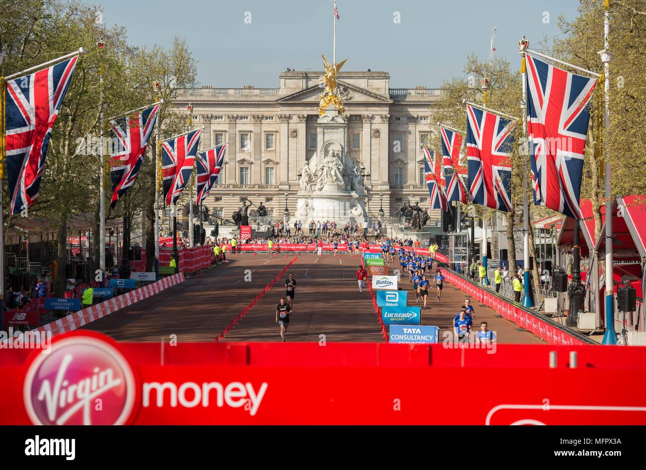 22 April 2018, The Mall, London UK. Junior runners on the finishing straight of the Virgin Money London Marathon 2018 circuit. - Stock Image