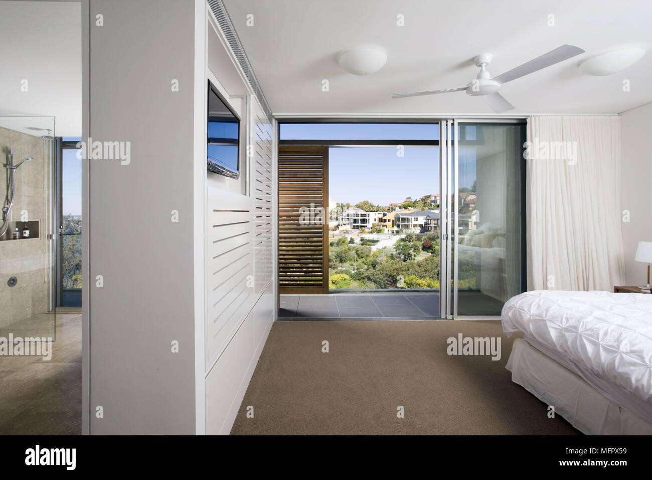3c0459aca498 Modern bedroom with sliding doors to balcony terrace Stock Photo ...