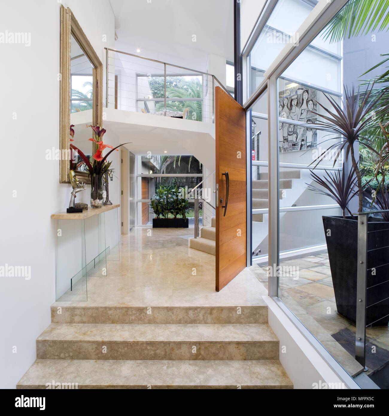 Modern Front Door Into Entrance Hallway With Marble Floor Stock Photo Alamy