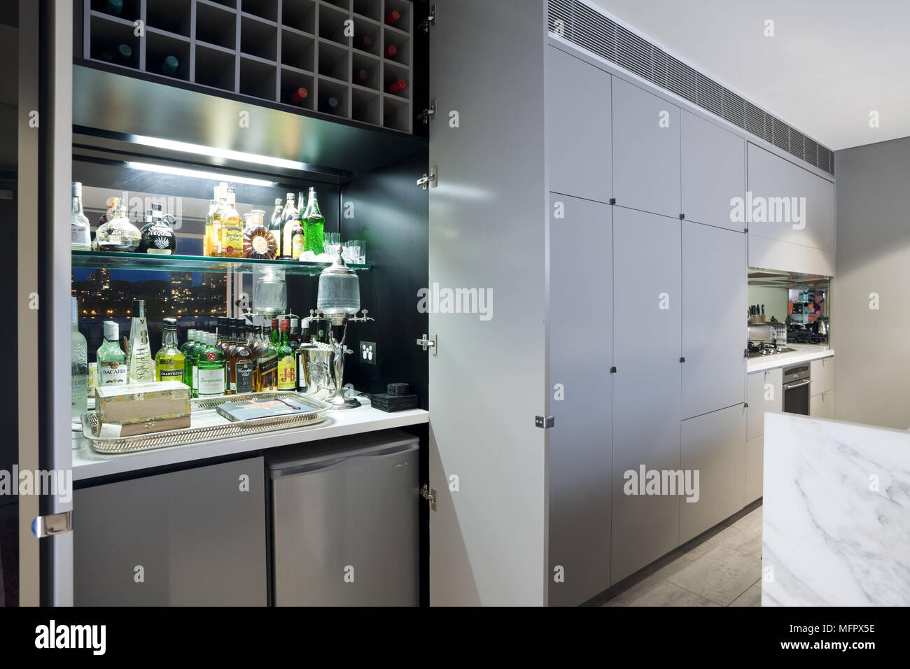 Modern Kitchen With Bar Unit And Chiller Set In Recessed Cupboard