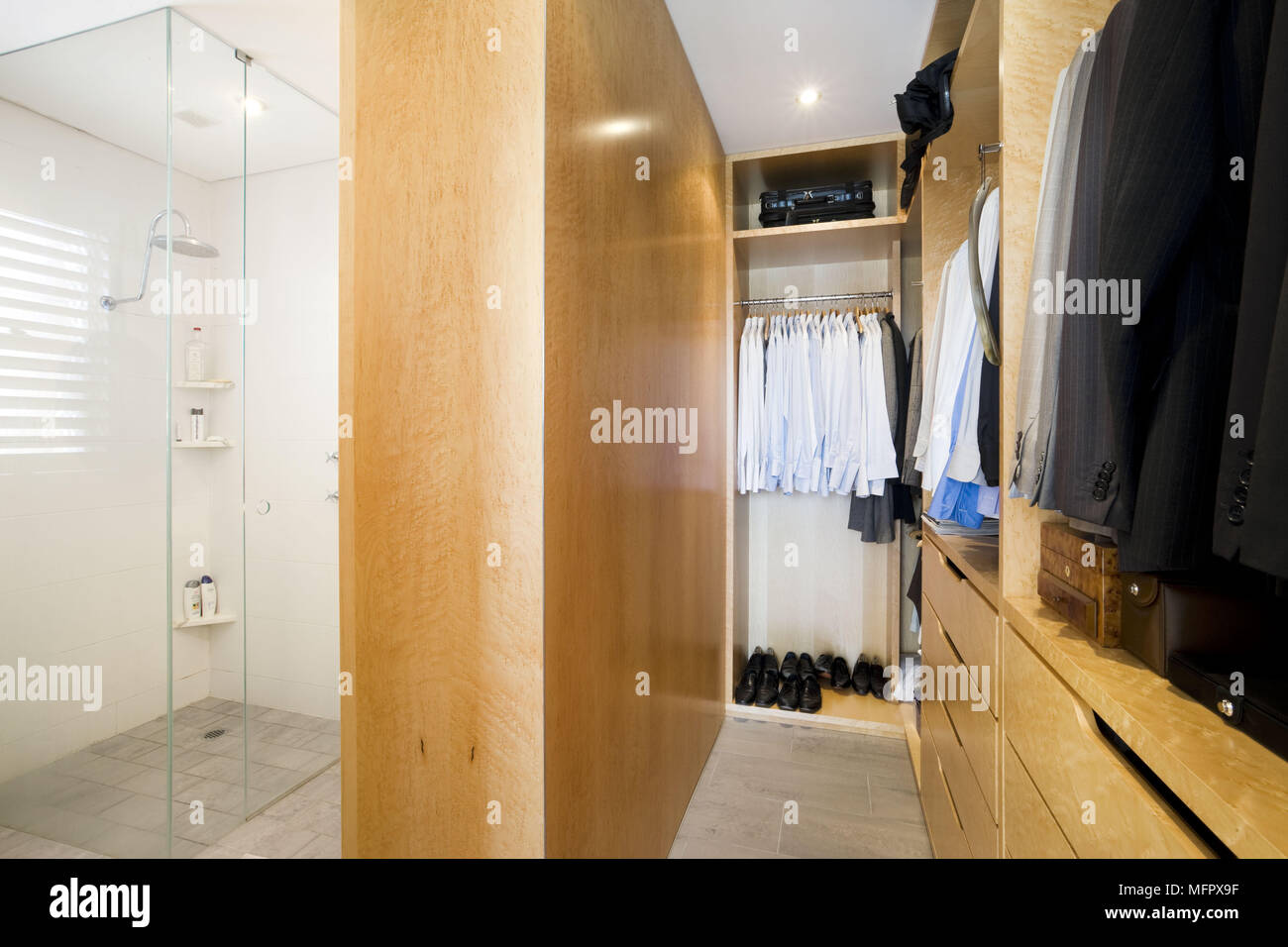 Shower Cubicle Separated From Dressing Room By Wood Partition Wall