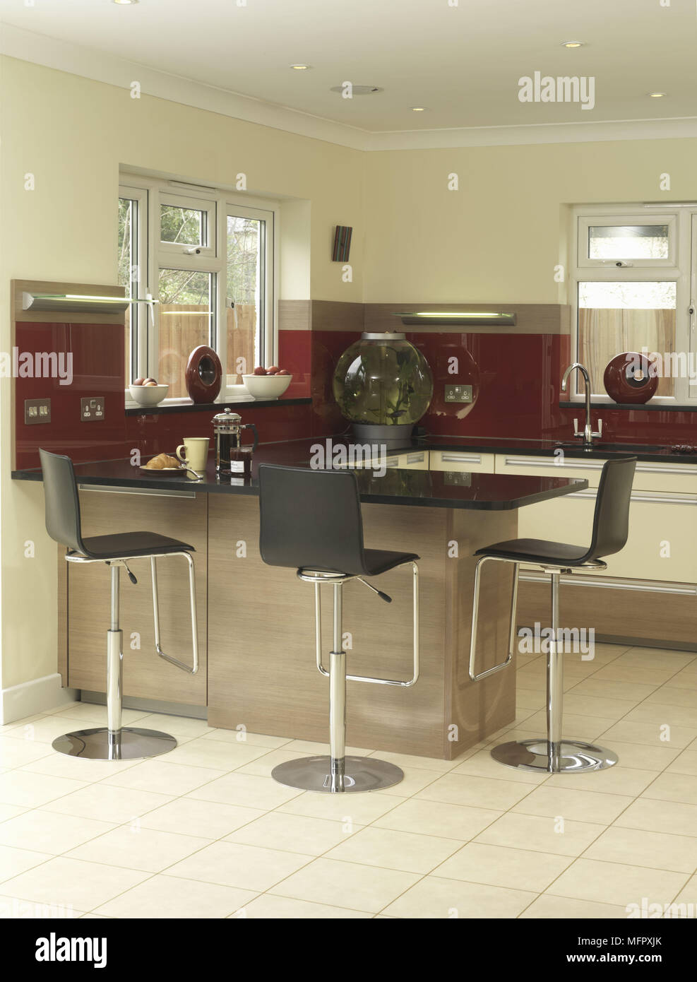 Bar Stools At Peninsula Breakfast Bar Unit In Modern Kitchen ...