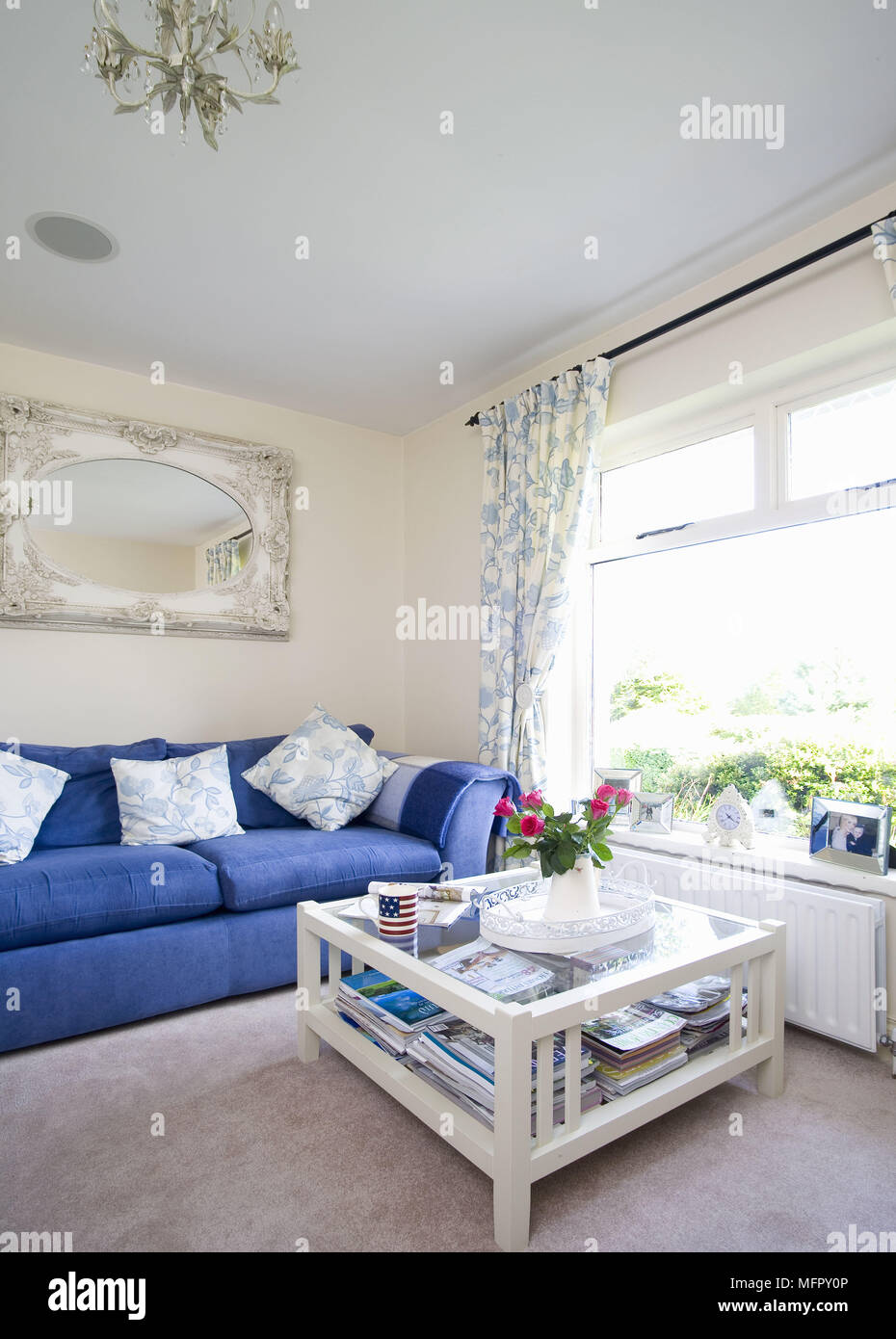 Coffee Table In Front Of Blue Sofa In Traditional Style Sitting Room Stock Photo Alamy