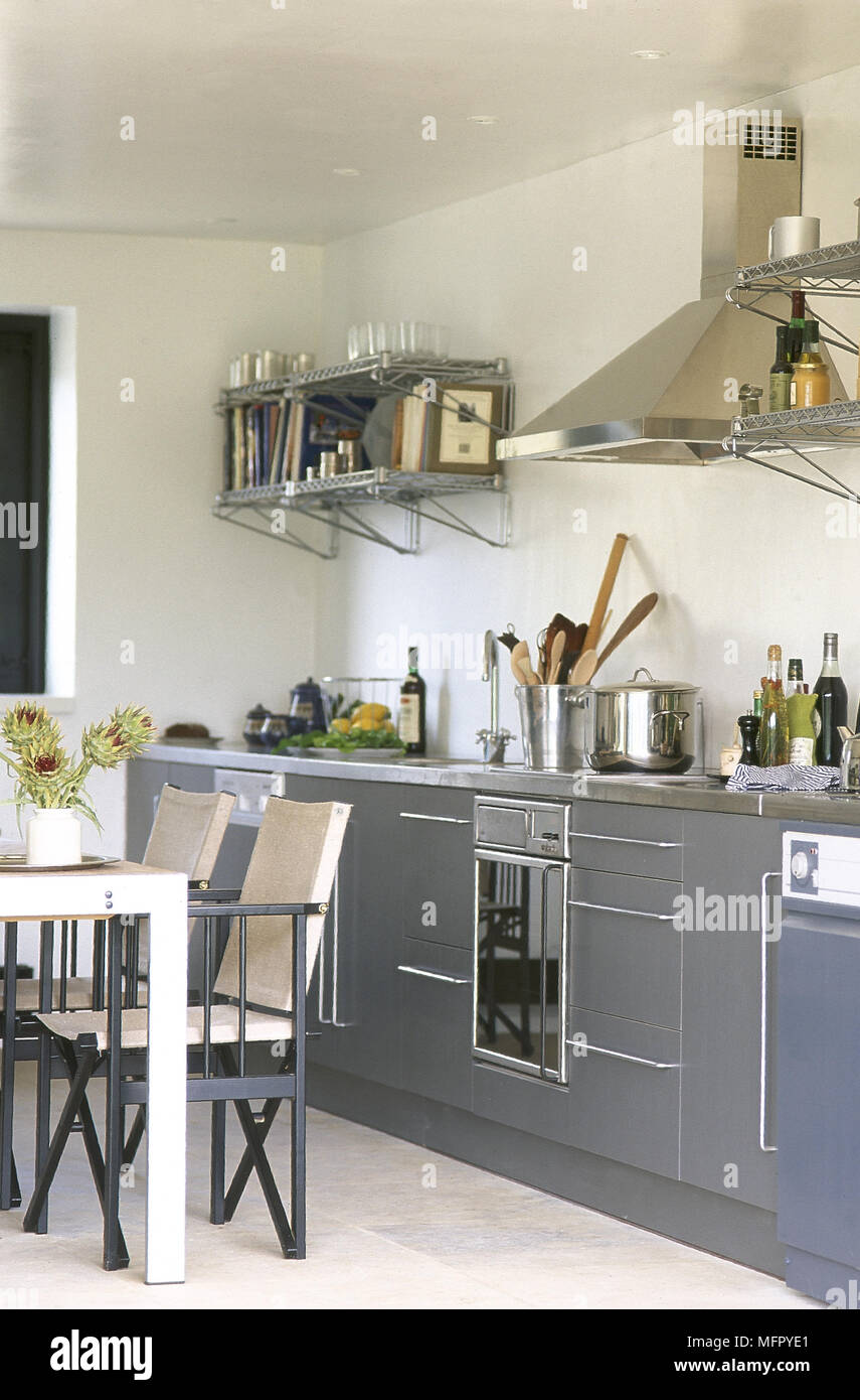 Modern, eat-in kitchen with tiled floor, grey cabinets ...
